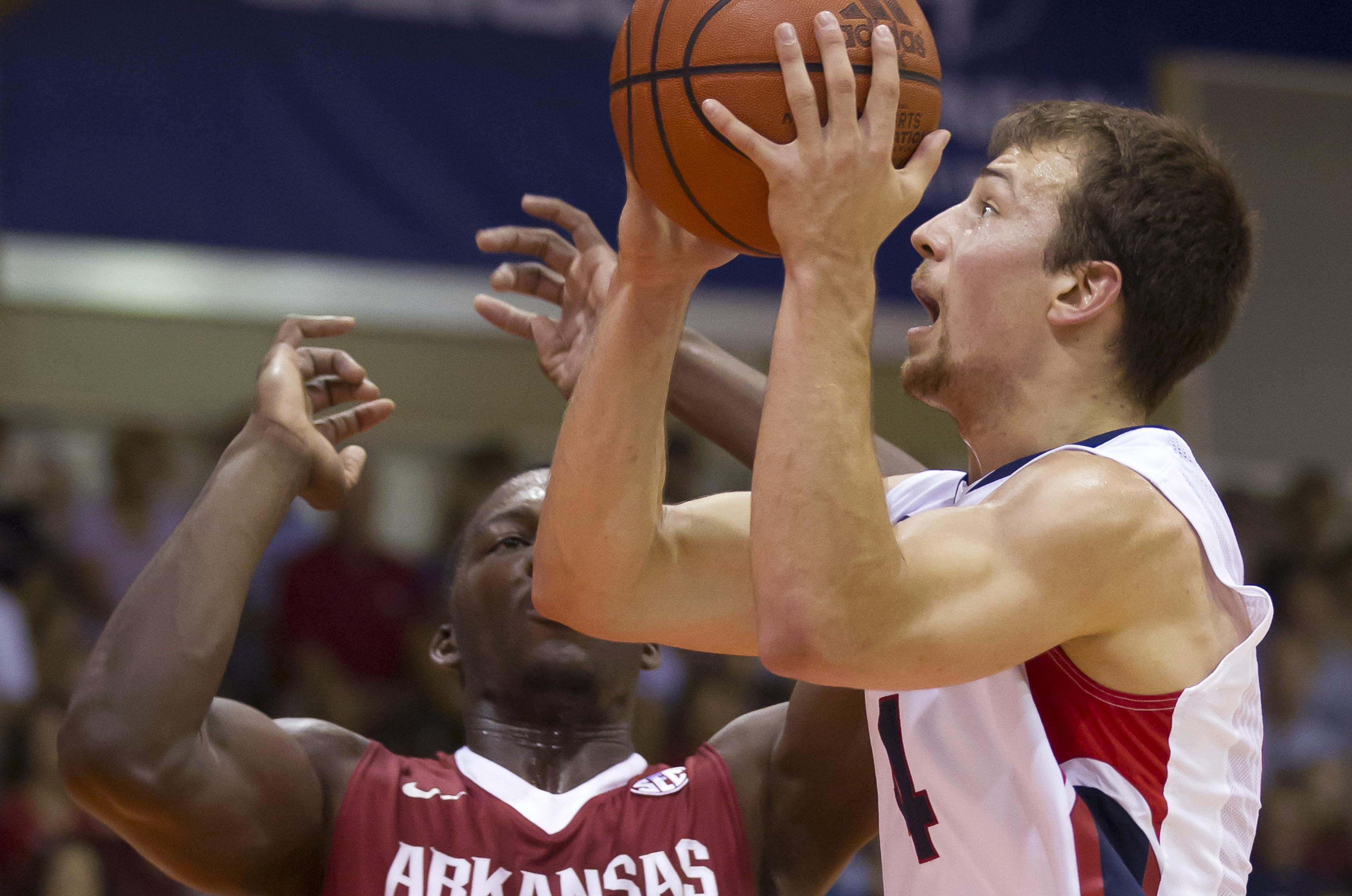 Gonzaga's Kevin Pangos drives on Arkansas foward Alandise Harris at the 2013 Maui Invitational. Pangos
