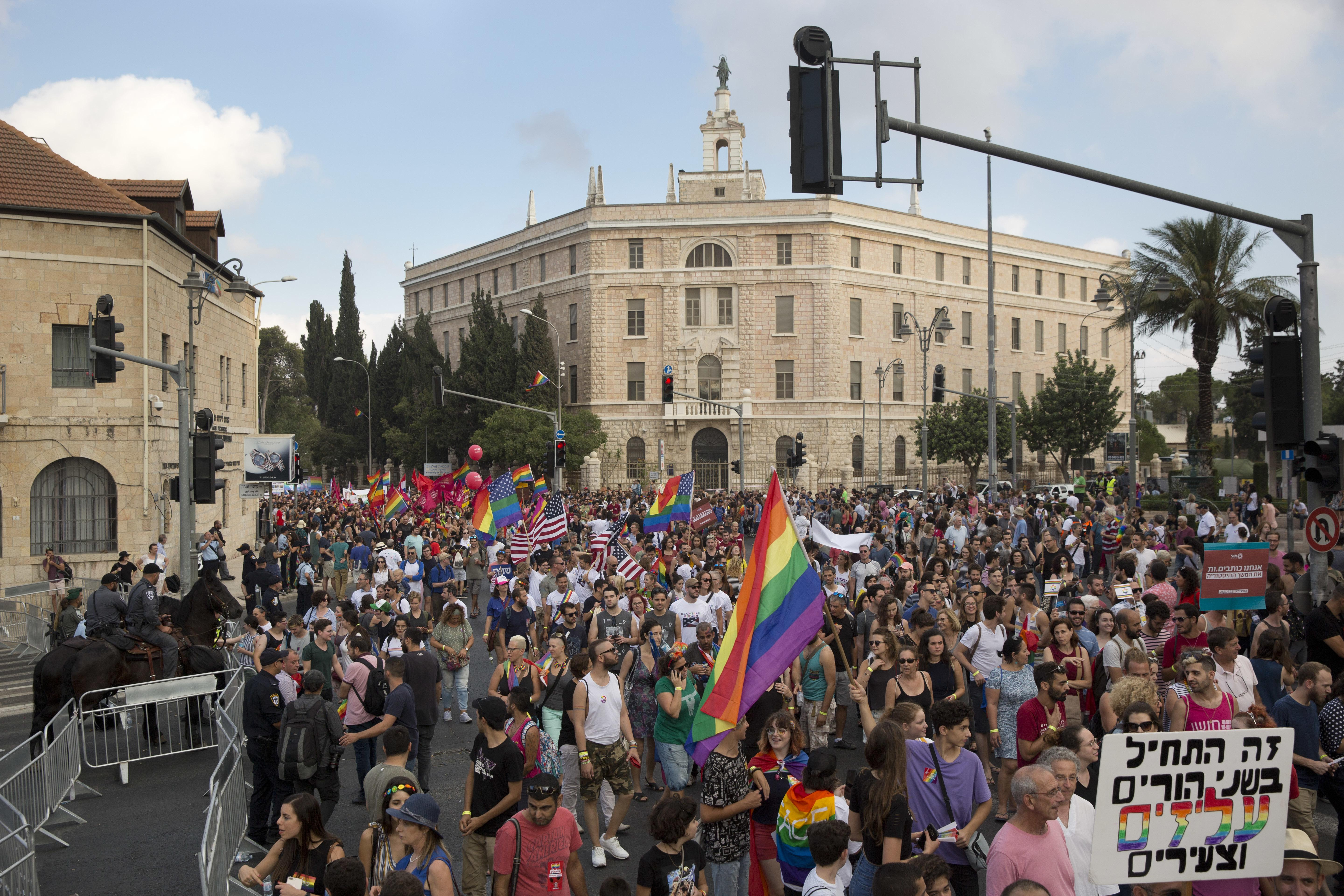 Participants wave LGBT pride rainbow flags during annual Gay Pride parade  in Jerusalem, on Thursday