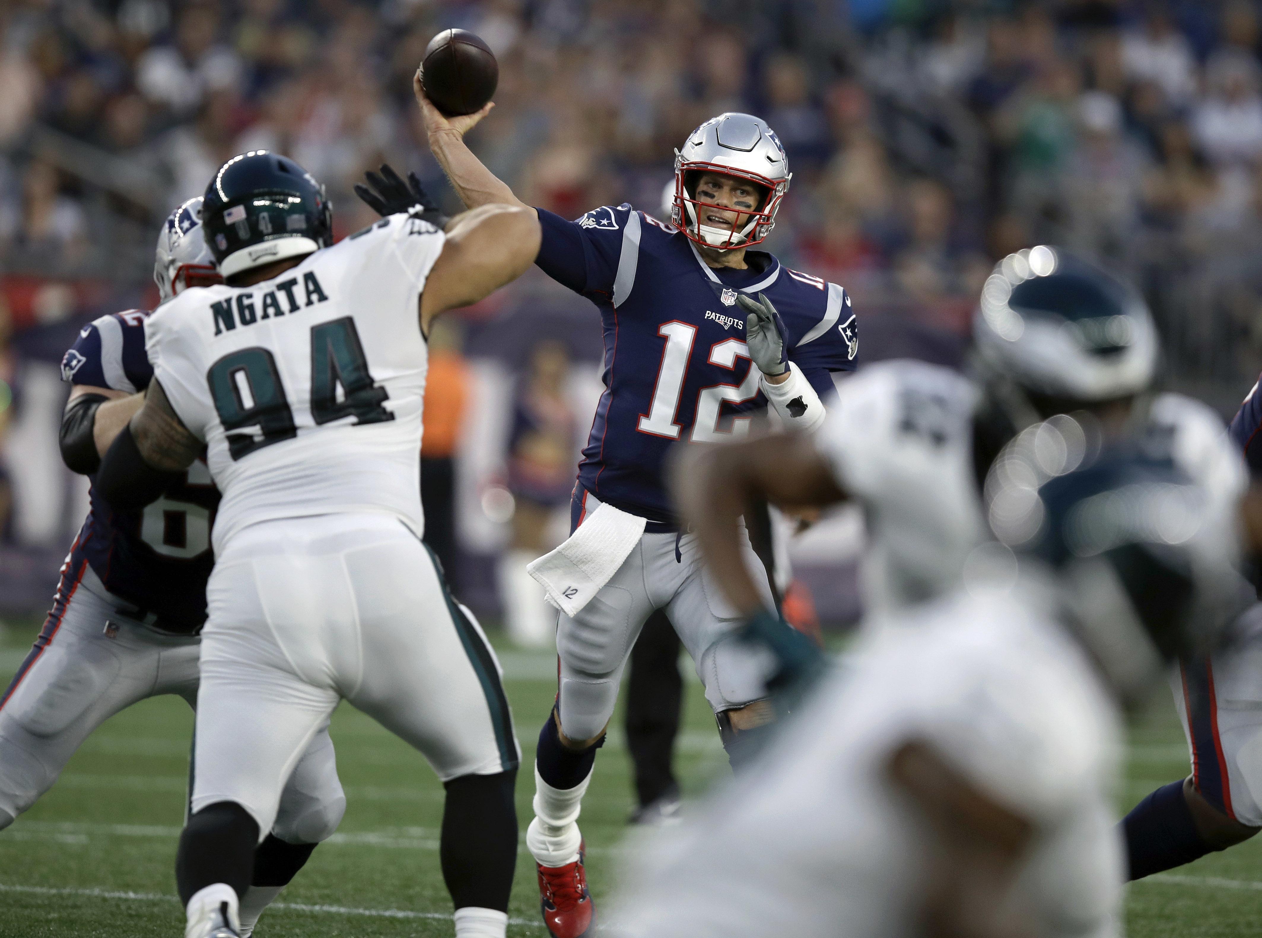 df07268fb2f New England Patriots quarterback Tom Brady (12) throws a pass under  pressure from Philadelphia