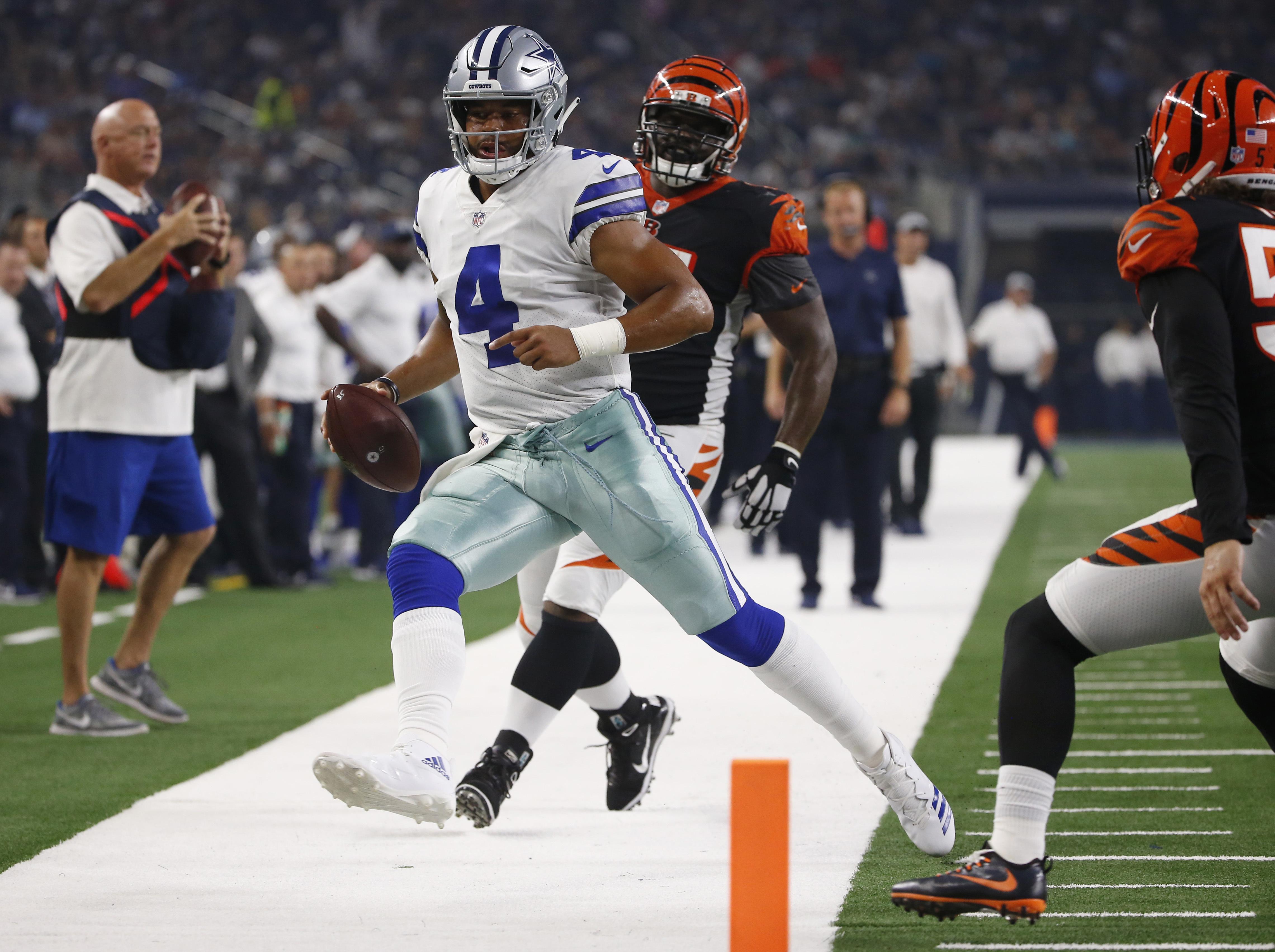 Dallas Cowboys quarterback Dak Prescott is forced out of bounds as he  scrambles against the Cincinnati fa70fdd47