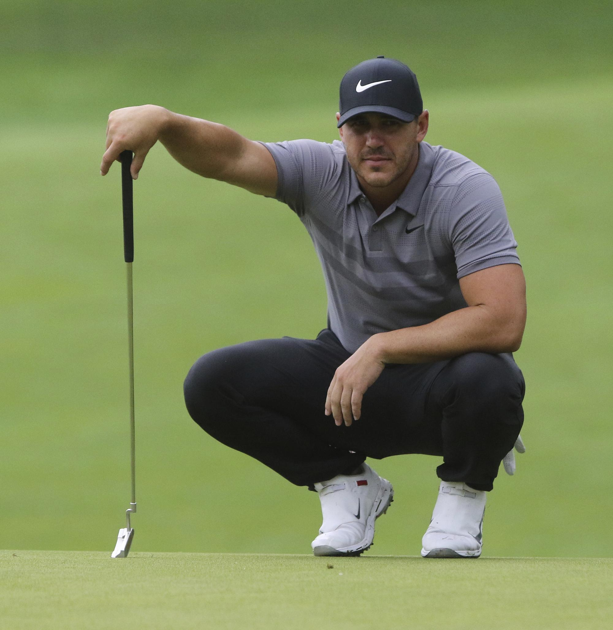 dc164e85 Brooks Koepka lines up a putt during a practice round for the Northern  Trust golf tournament