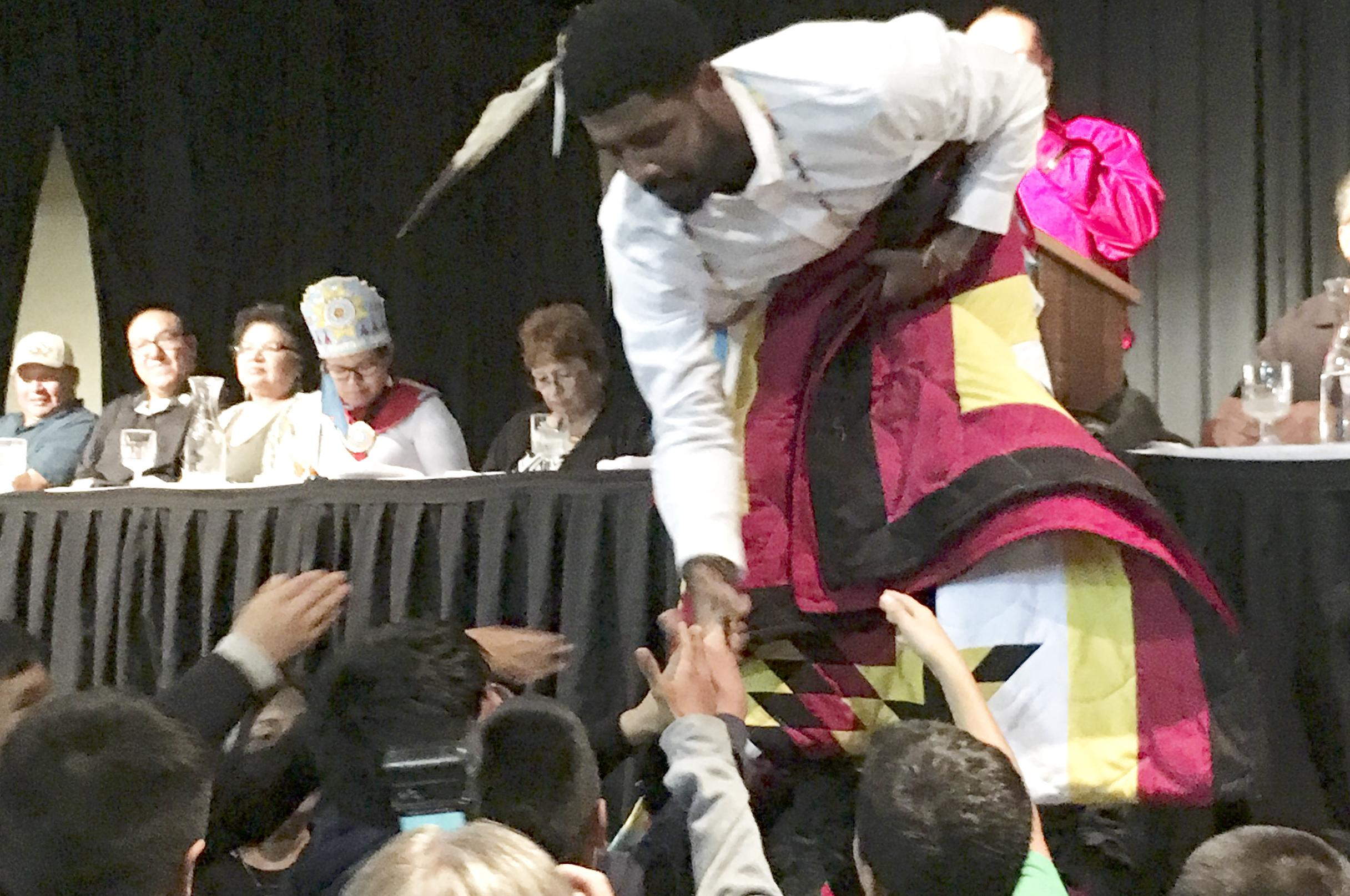 6675aa37b9f6 Boston Celtics basketball star Kyrie Irving accepts gifts from students on  the Standing Rock Indian Reservation