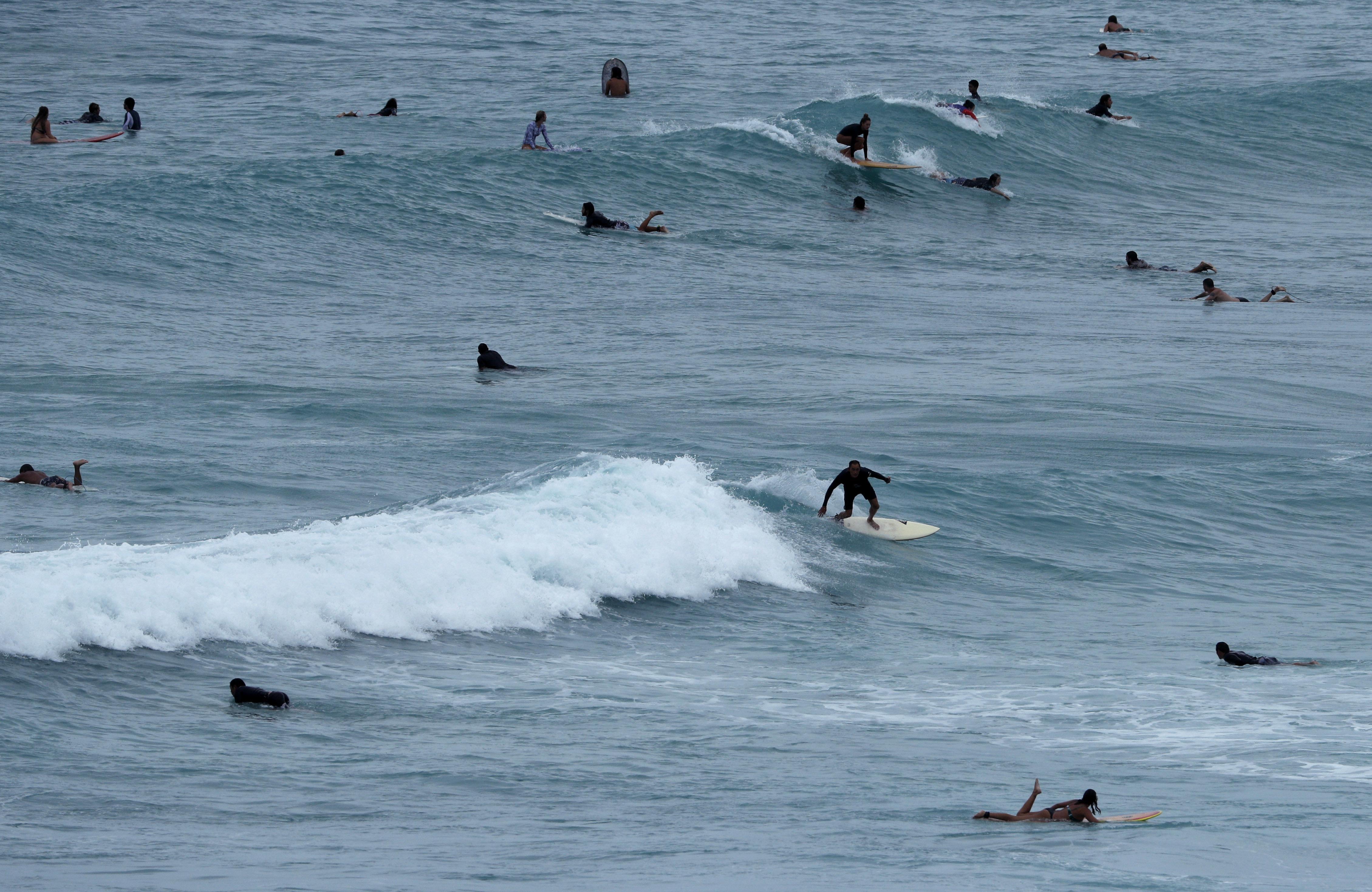 People Surf Off Waikiki Beach Ahead Of Hurricane Lane On Thursday Aug 23