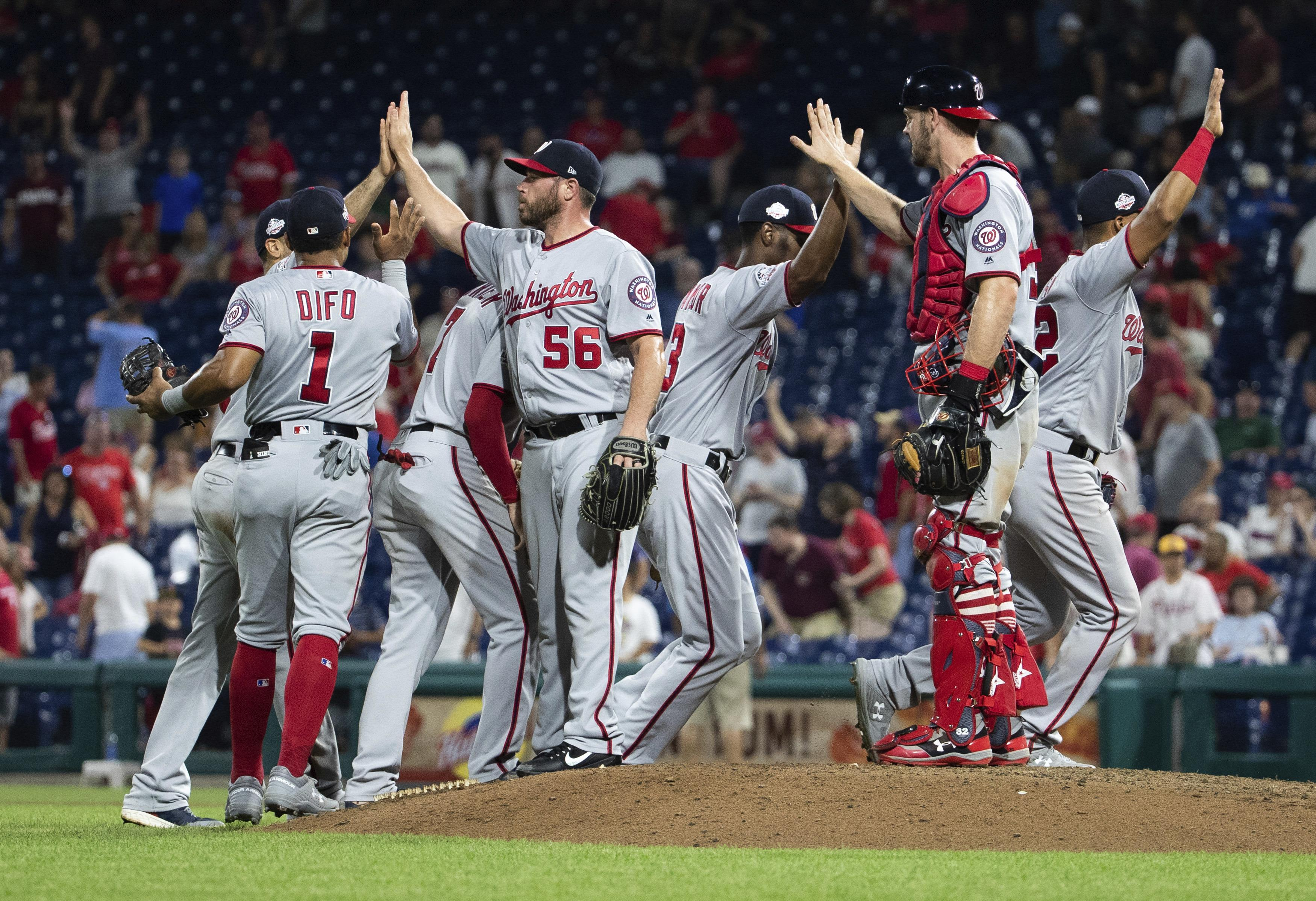 d5d512bb The Washington Nationals celebrate their 5-4 win after the ninth inning of  a baseball