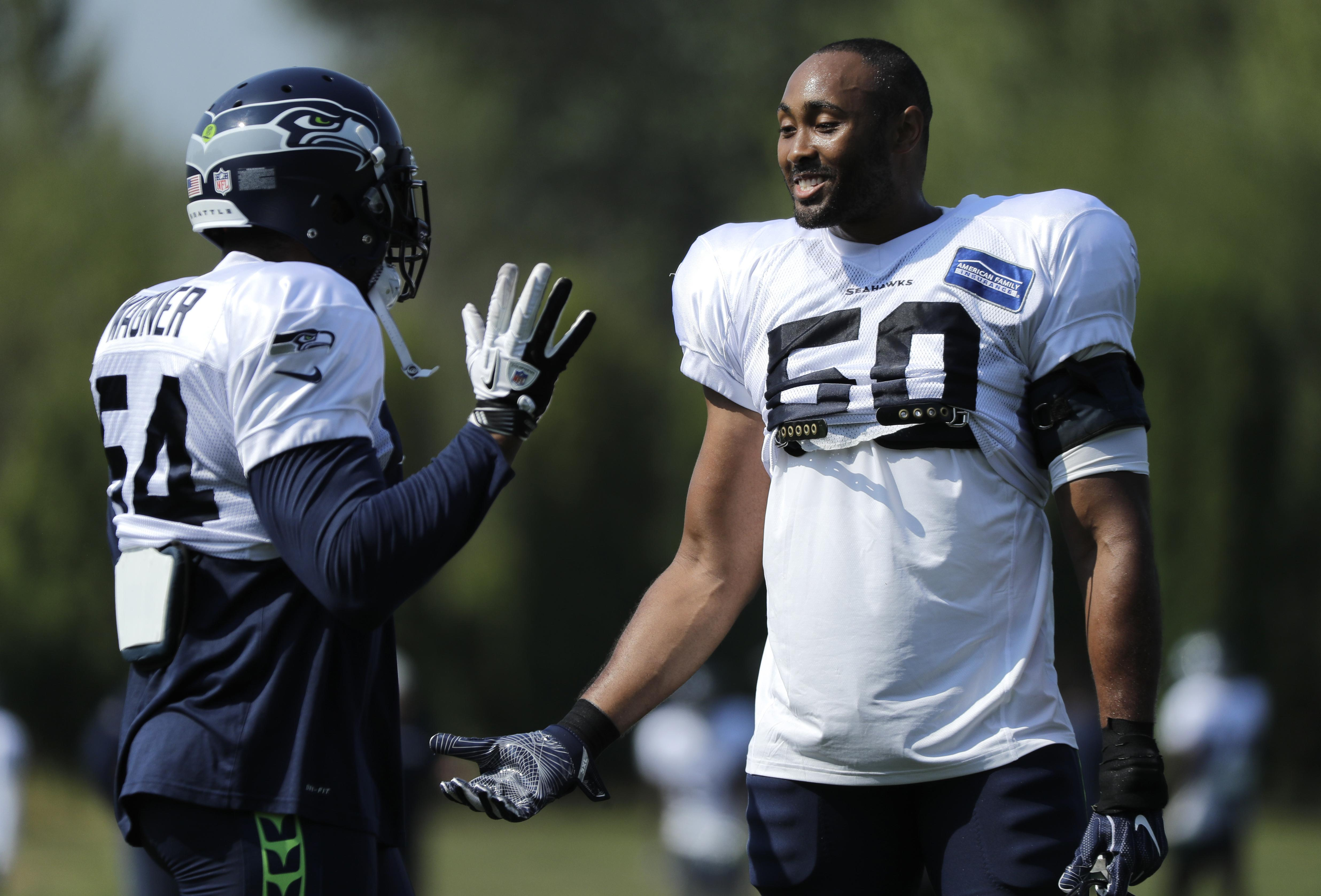Pete Carroll: K J  Wright likely out couple of weeks for