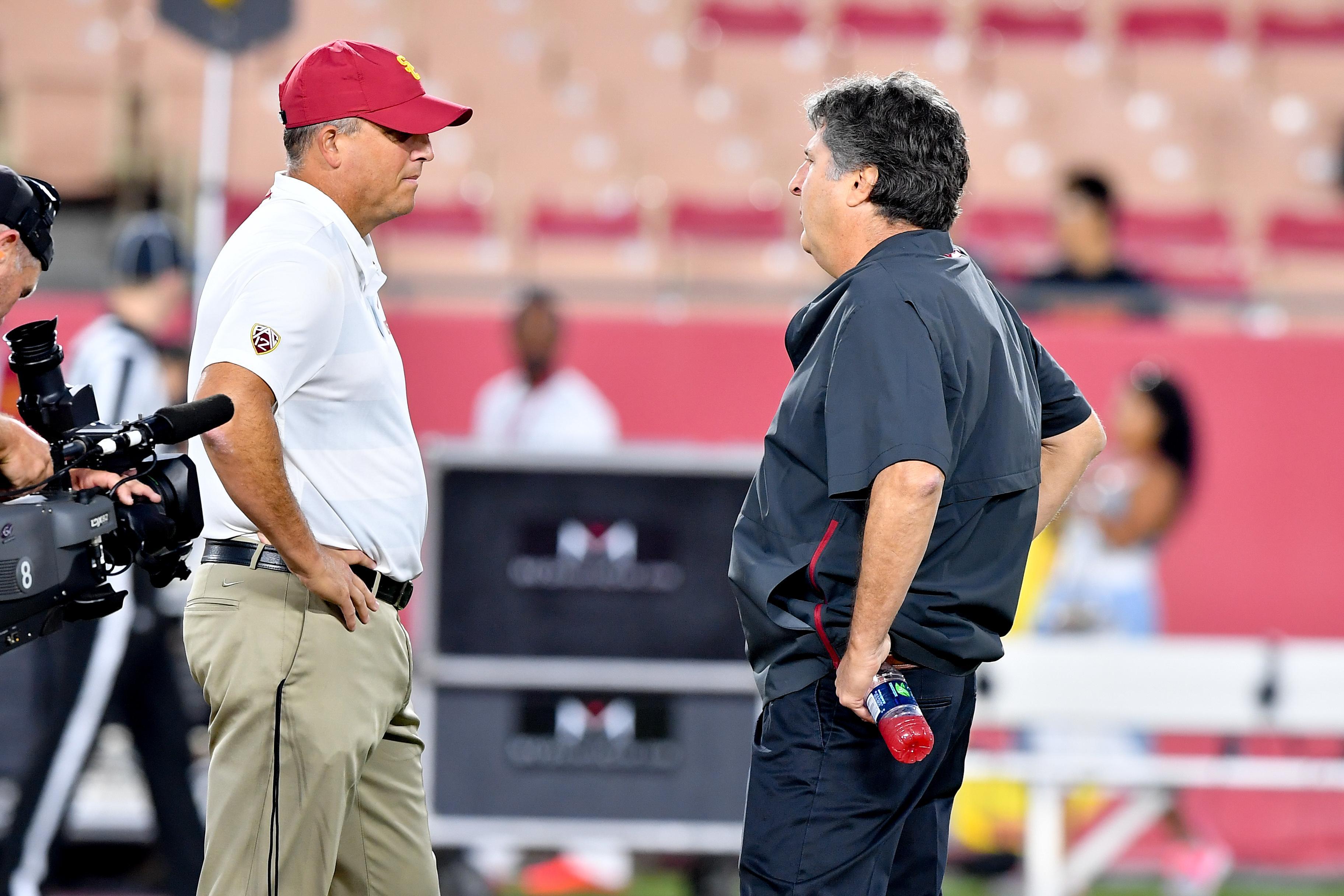 c6b4eafc67a Washington State Cougars head coach Mike Leach and USC Trojans head coach  Clay Helton chat before