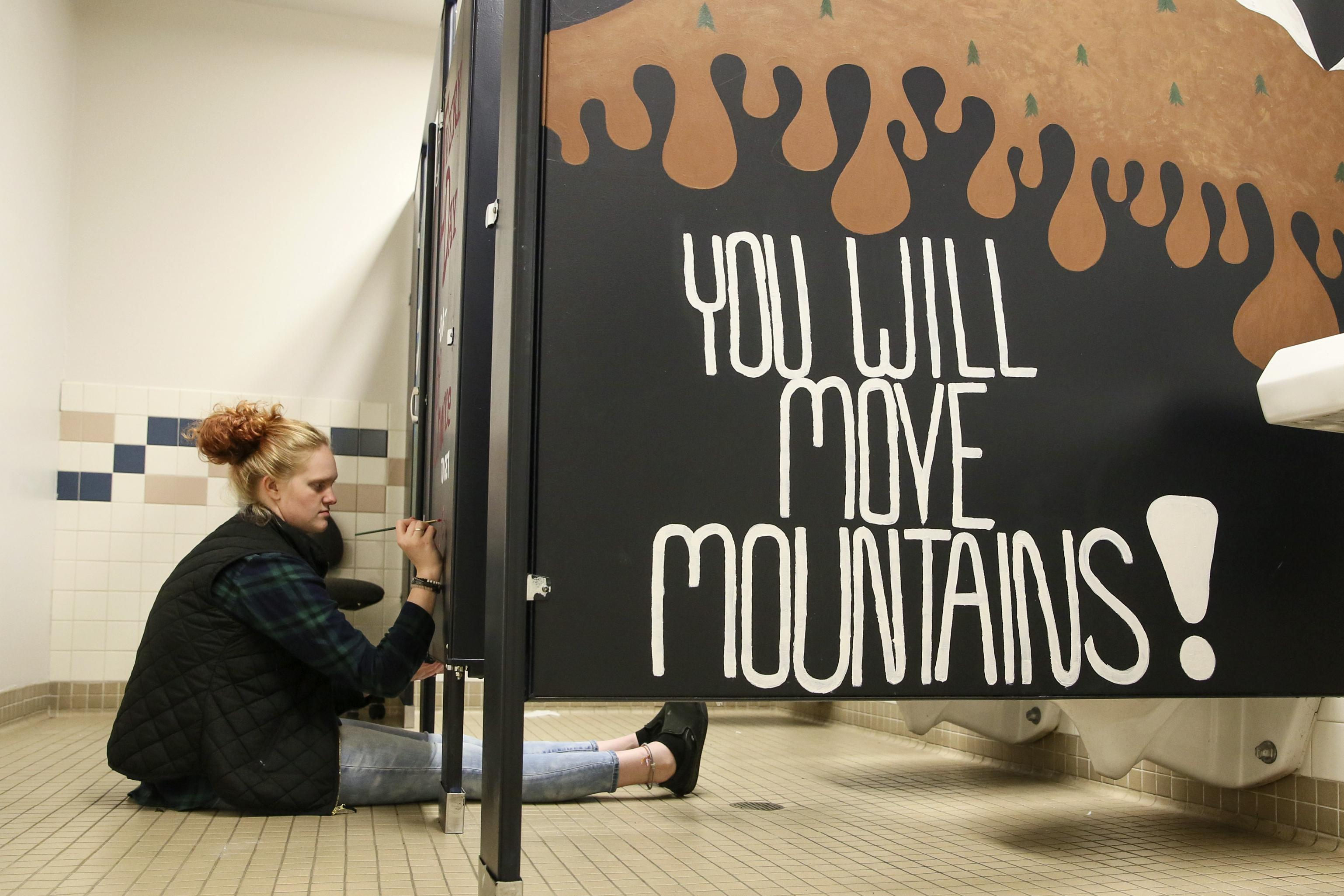 The Writing On The Stalls Students Paint Messages Of Hope