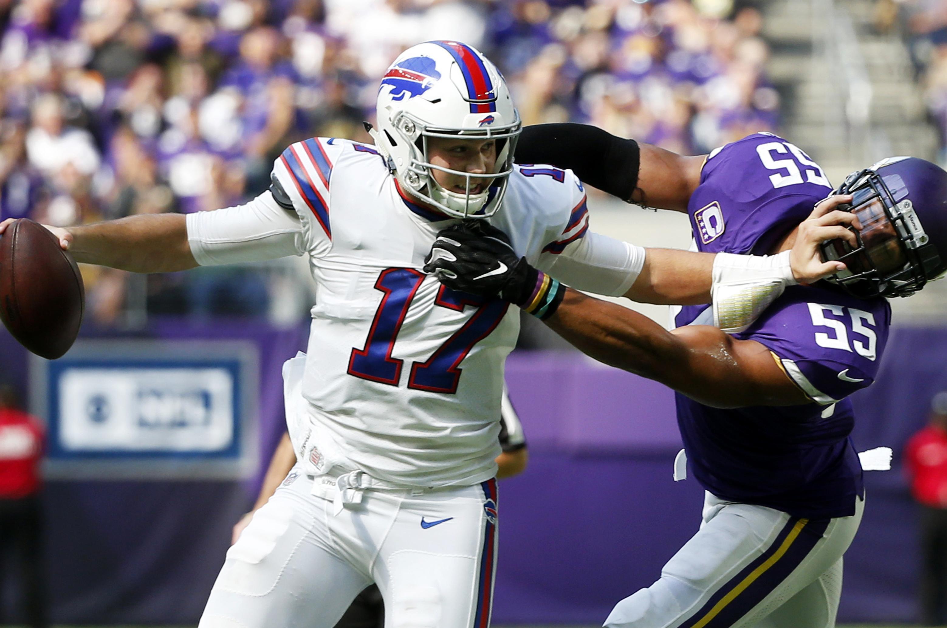 142dd660930 Buffalo Bills quarterback Josh Allen tries to break a tackle by Minnesota  Vikings linebacker Anthony Barr