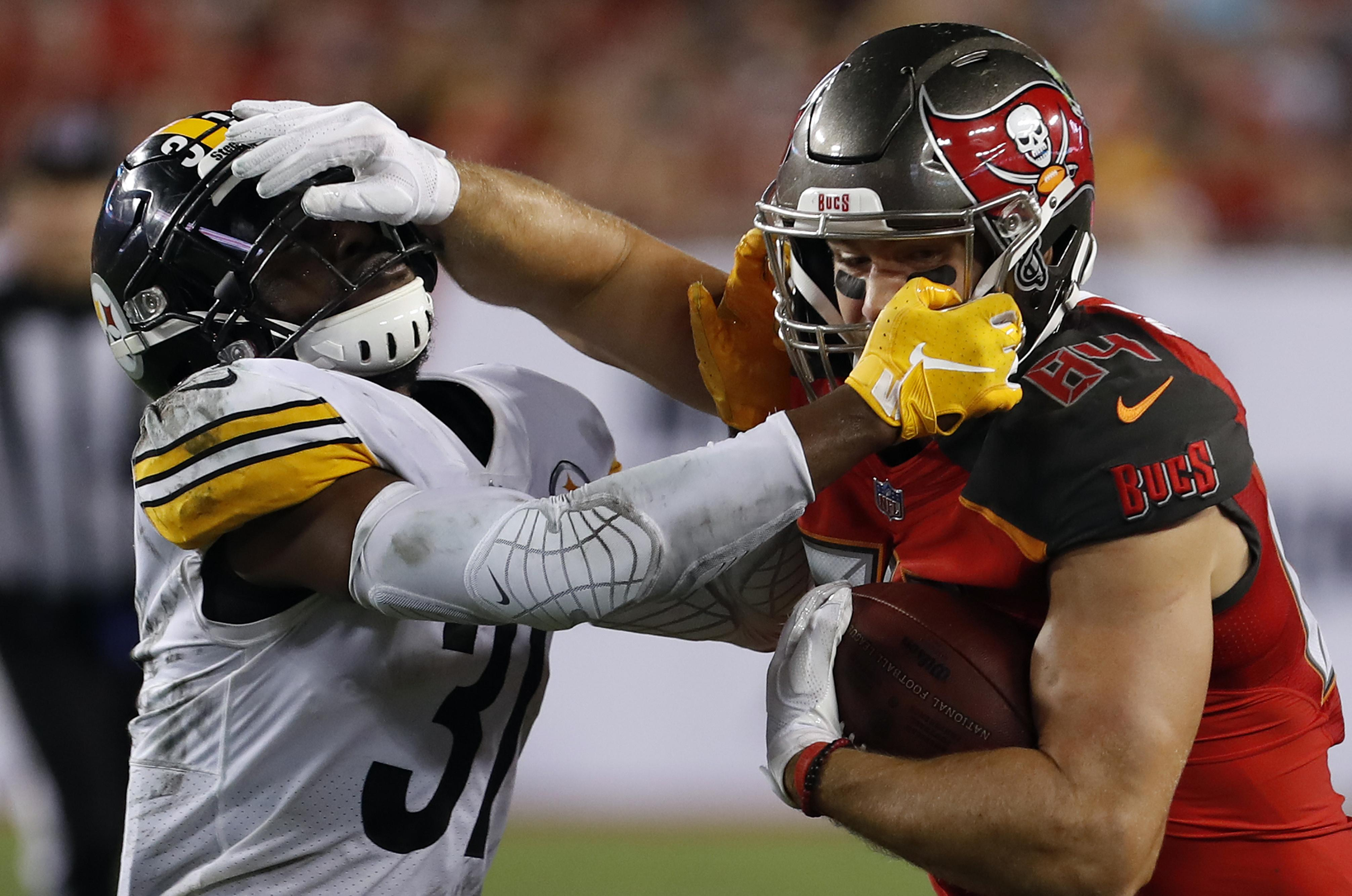 6097d4f89ea Tampa Bay Buccaneers tight end Cameron Brate (84) battles with Pittsburgh  Steelers defensive back
