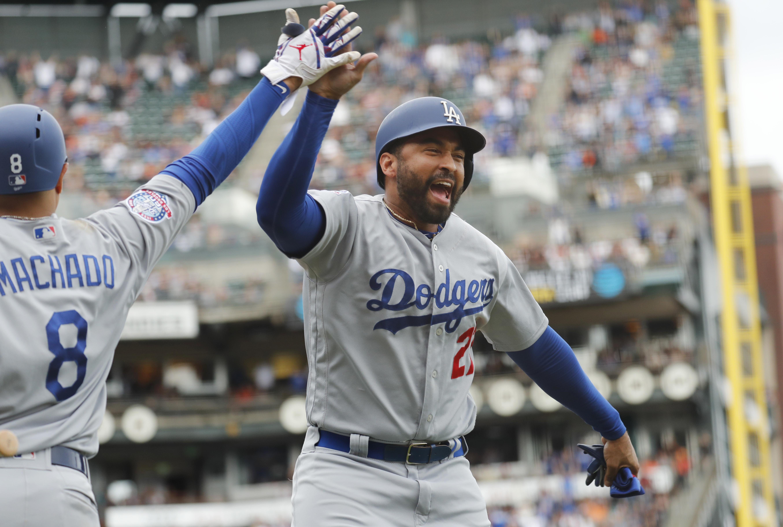 95661d501 Los Angeles Dodgers' Matt Kemp (27) celebrates with Manny Machado (8)