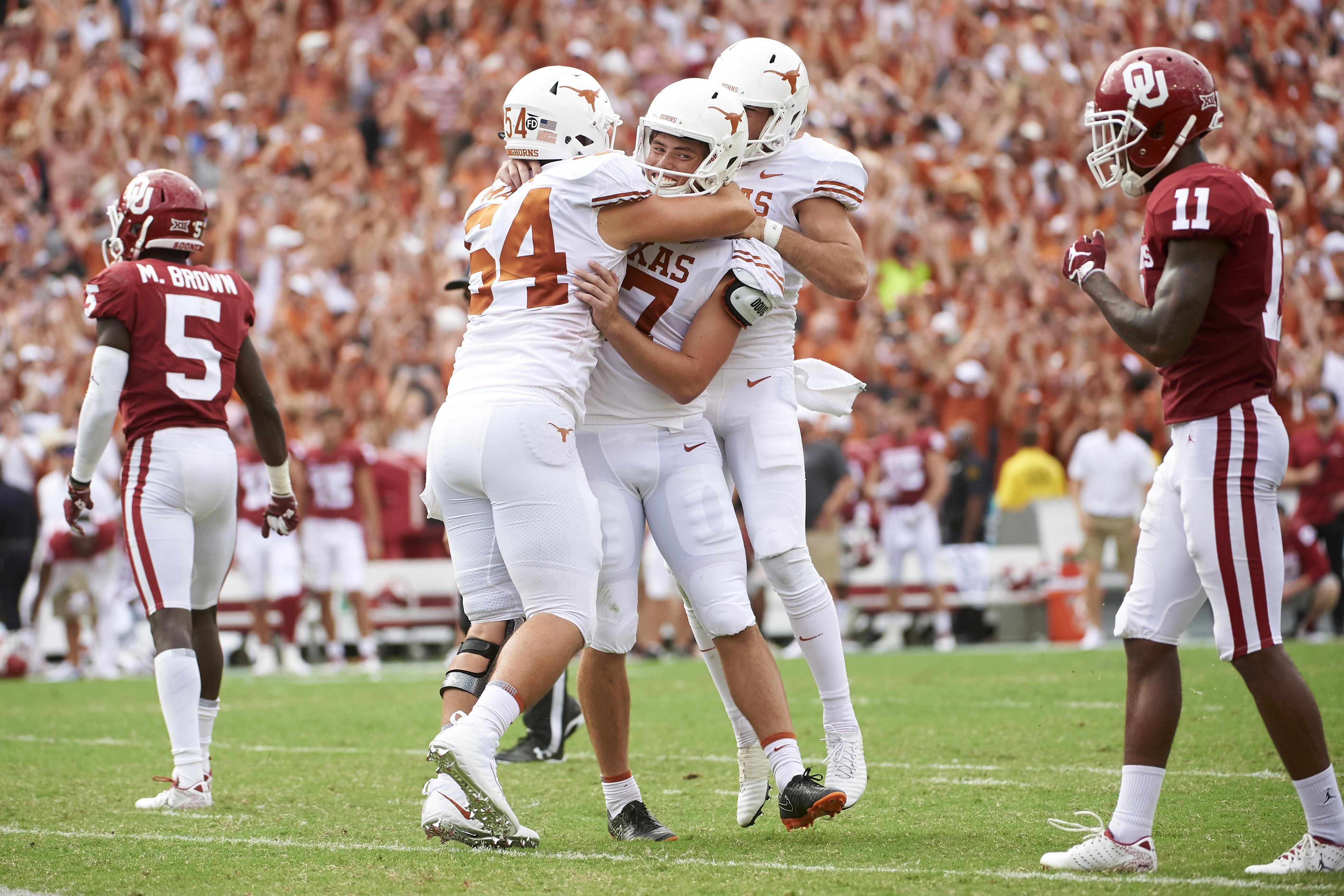 Top 25 roundup: No  19 Texas beats No  7 Oklahoma 48-45 on