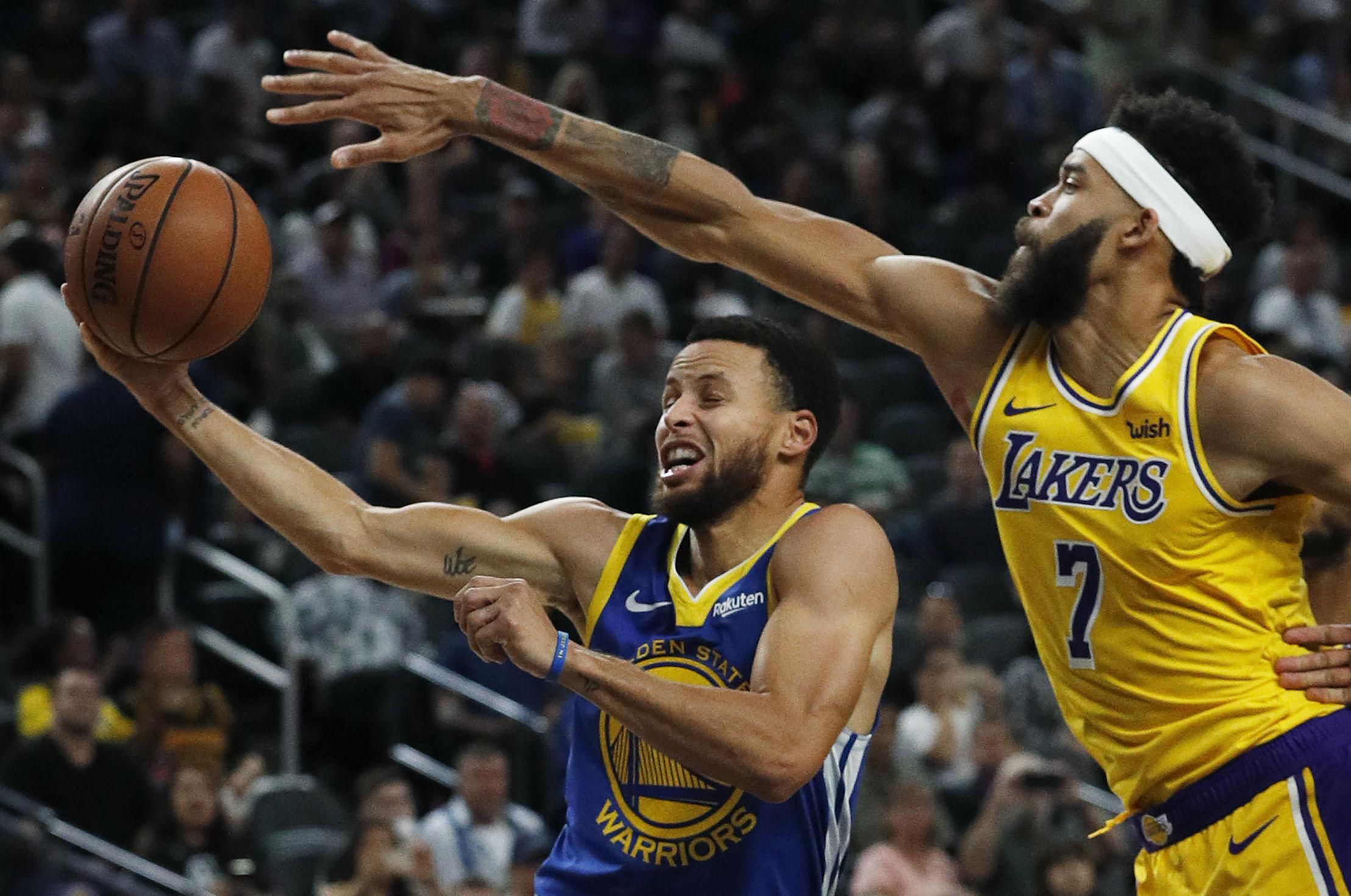 86c35f5f9 Golden State Warriors guard Stephen Curry shoots around Los Angeles Lakers  center JaVale McGee during the
