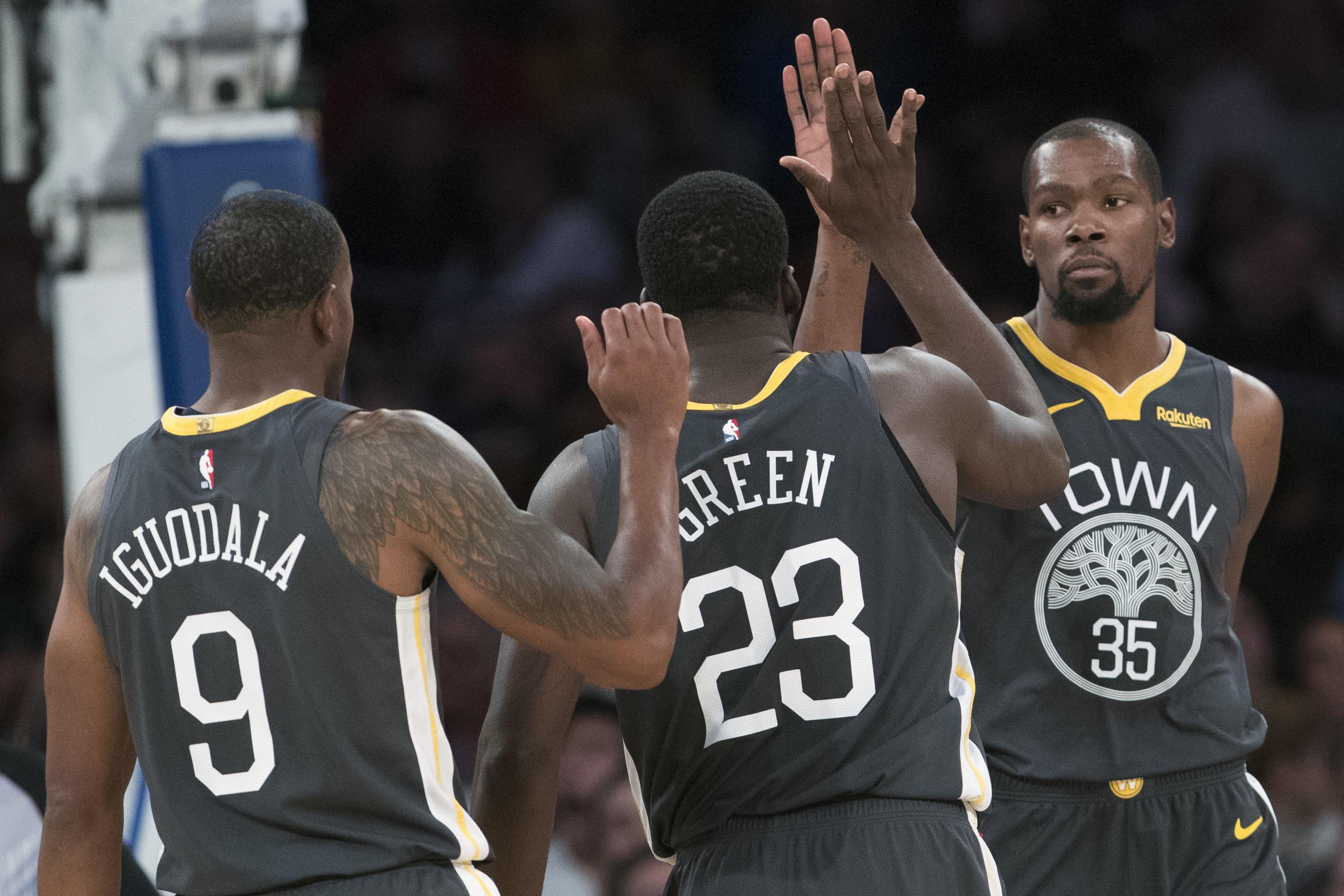 ff55ecbcbf3 Warriors  Andrew Iguodala and Draymond Green congratulate teammate Kevin  Durant after Durant scored two of
