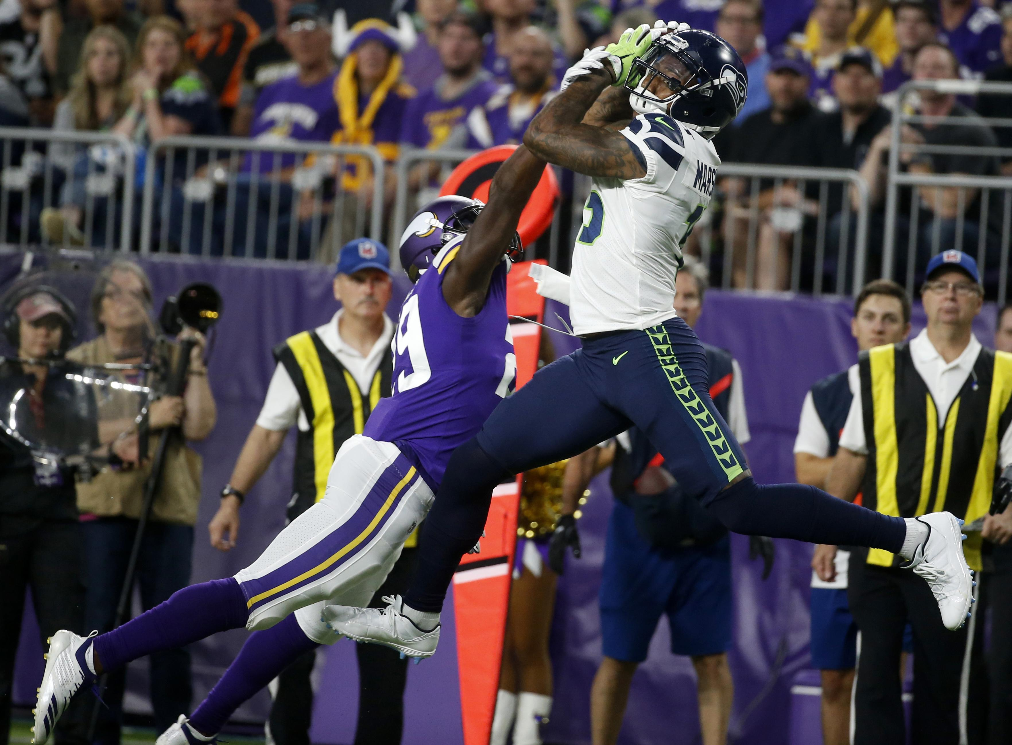 31ba02ed Seattle Seahawks wide receiver Brandon Marshall catches a pass over  Minnesota Vikings defensive back Xavier Rhodes