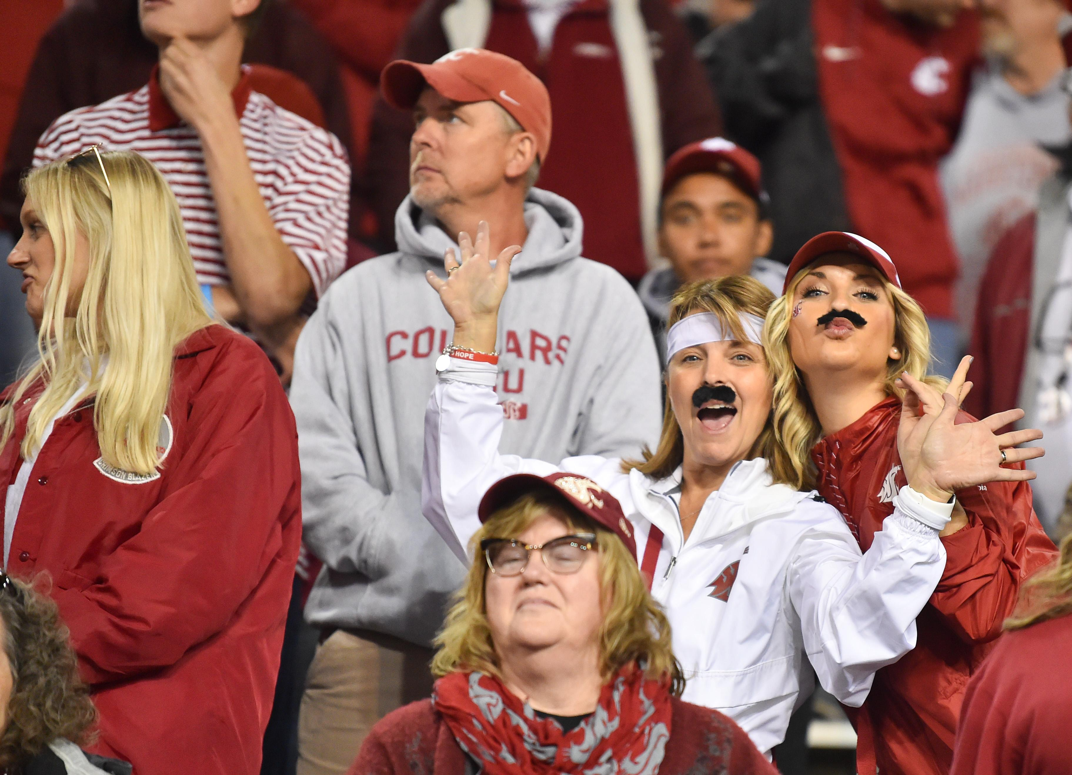 WSU fans took inspiration in faux facial grooming from quarterback Gardner  Minshew (16) during 80d6f68a1