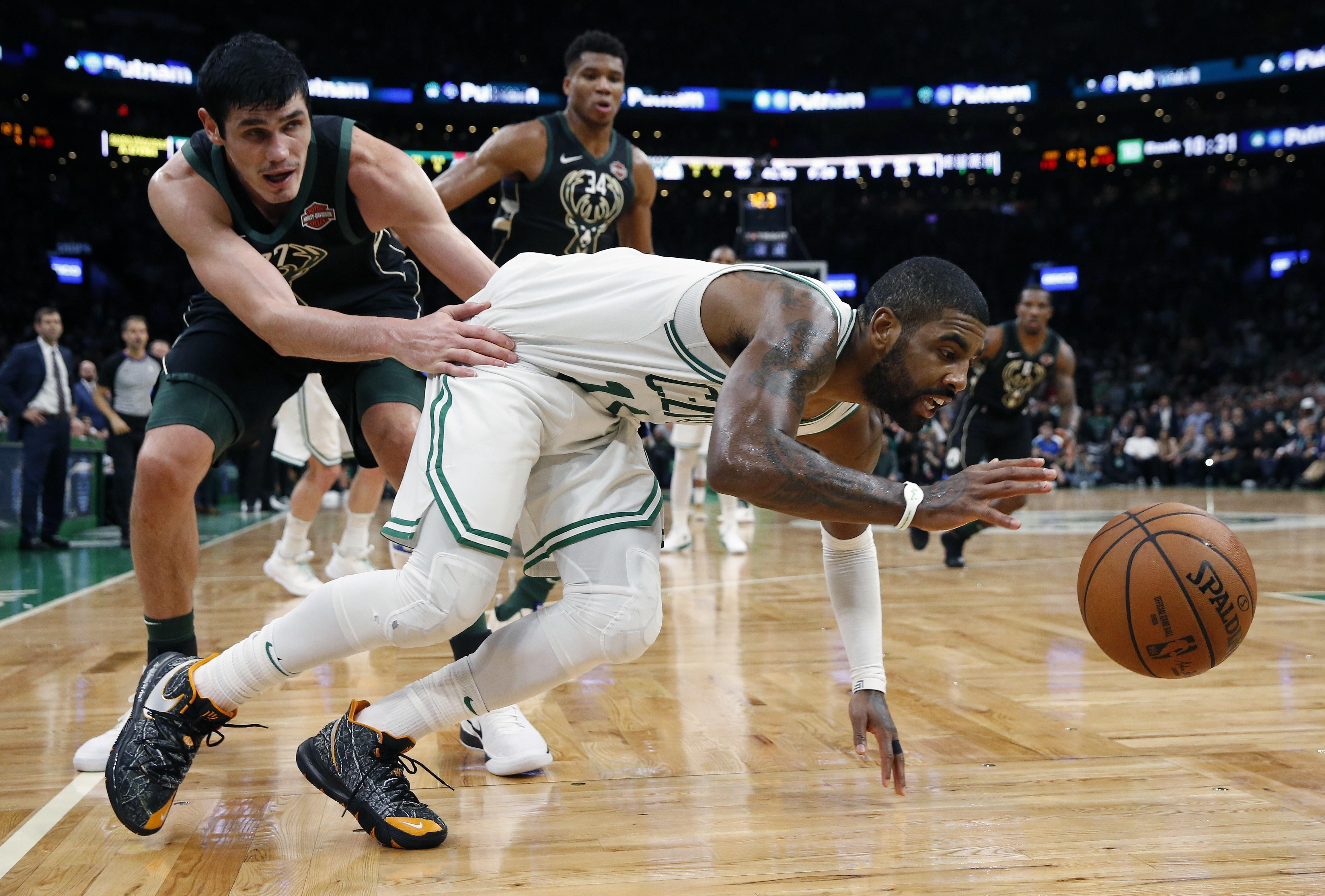 44cd536571cc Boston s Kyrie Irving drives past Milwaukee s Ersan Ilyasova during  second-half action on Thursday in