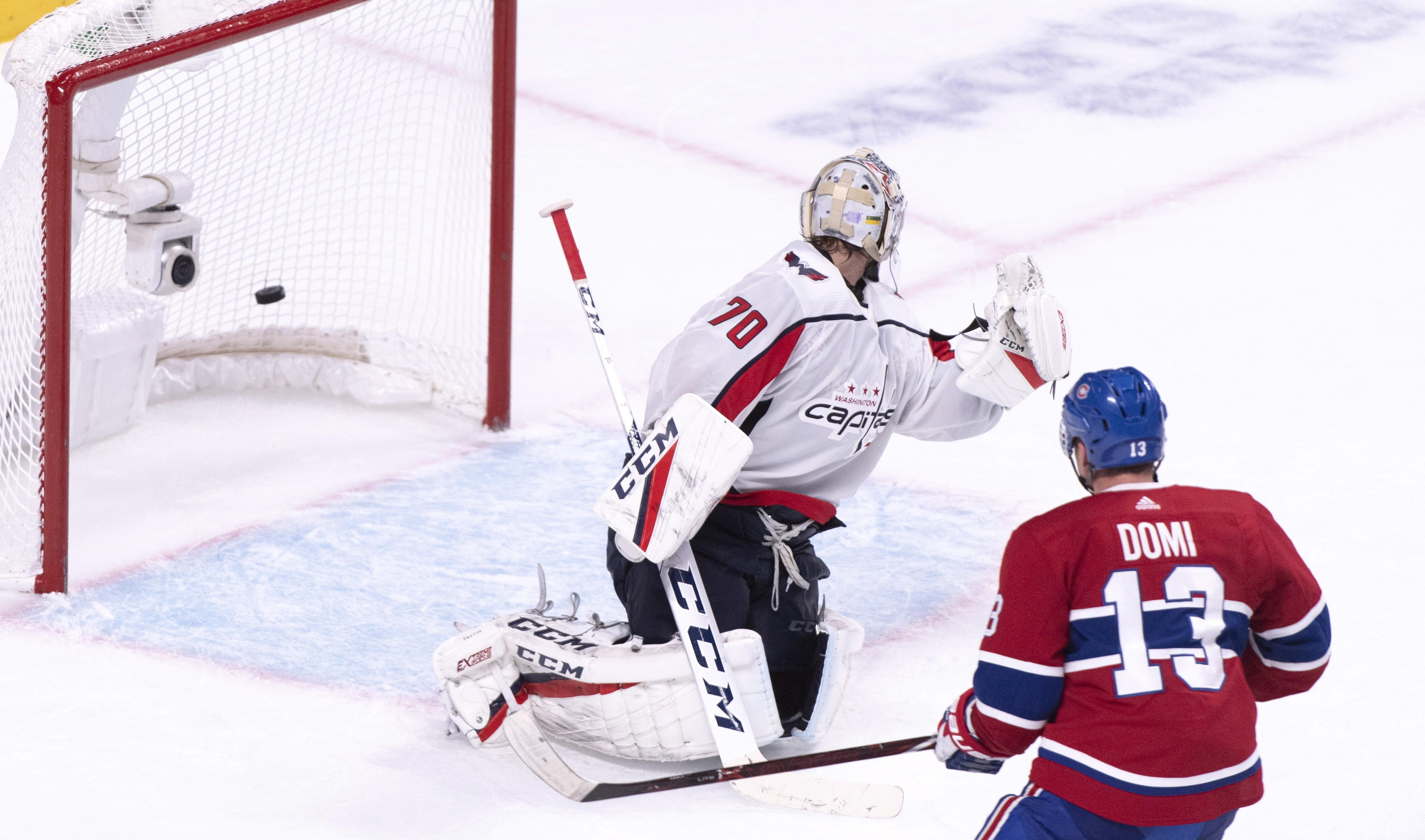 595cb3c7923 Montreal Canadiens  Max Domi scores the game-winner past Washington Capitals  goaltender Braden Holtby