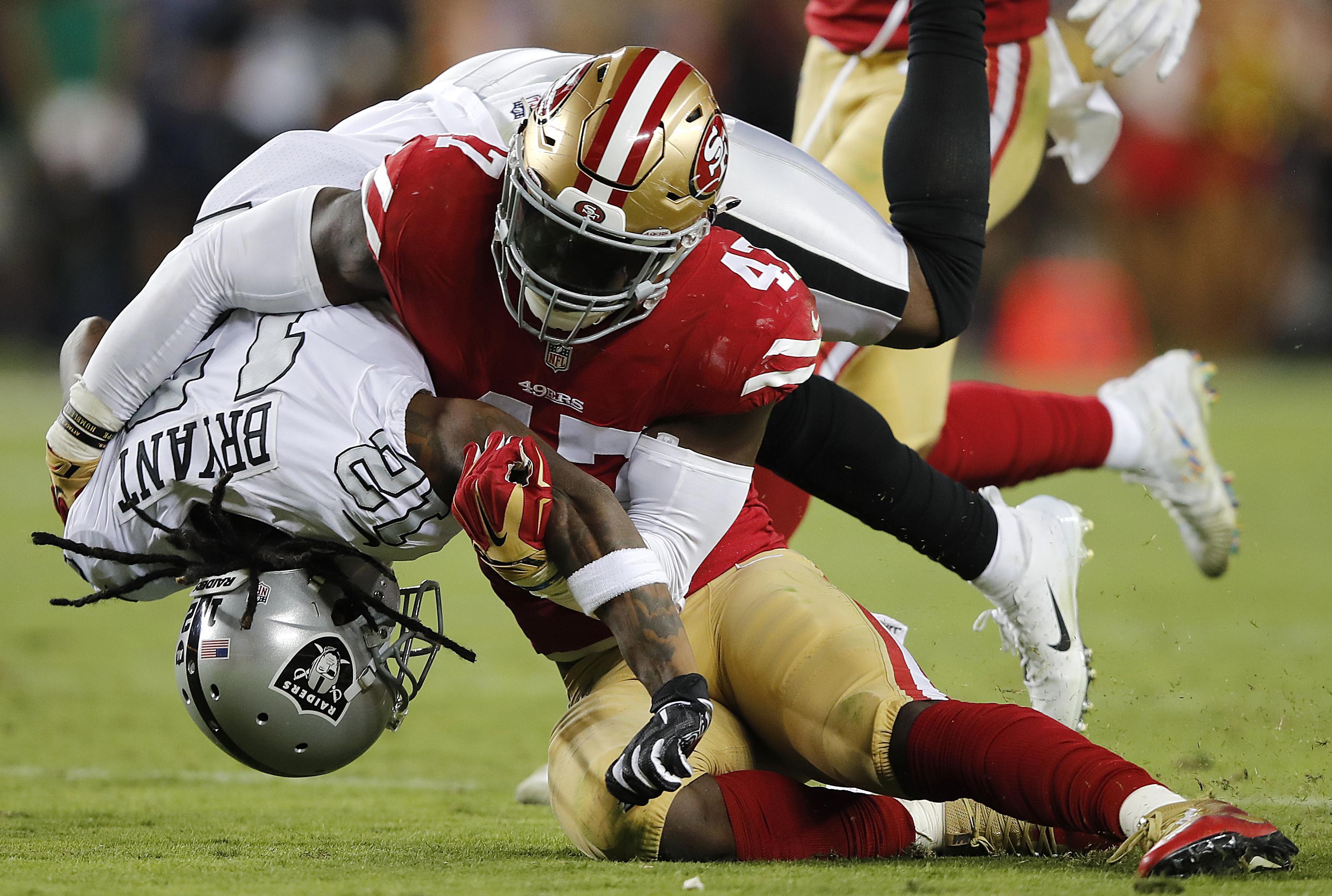 0a7d252a450 San Francisco 49ers linebacker Elijah Lee tackles Oakland Raiders wide  receiver Martavis Bryant during the second
