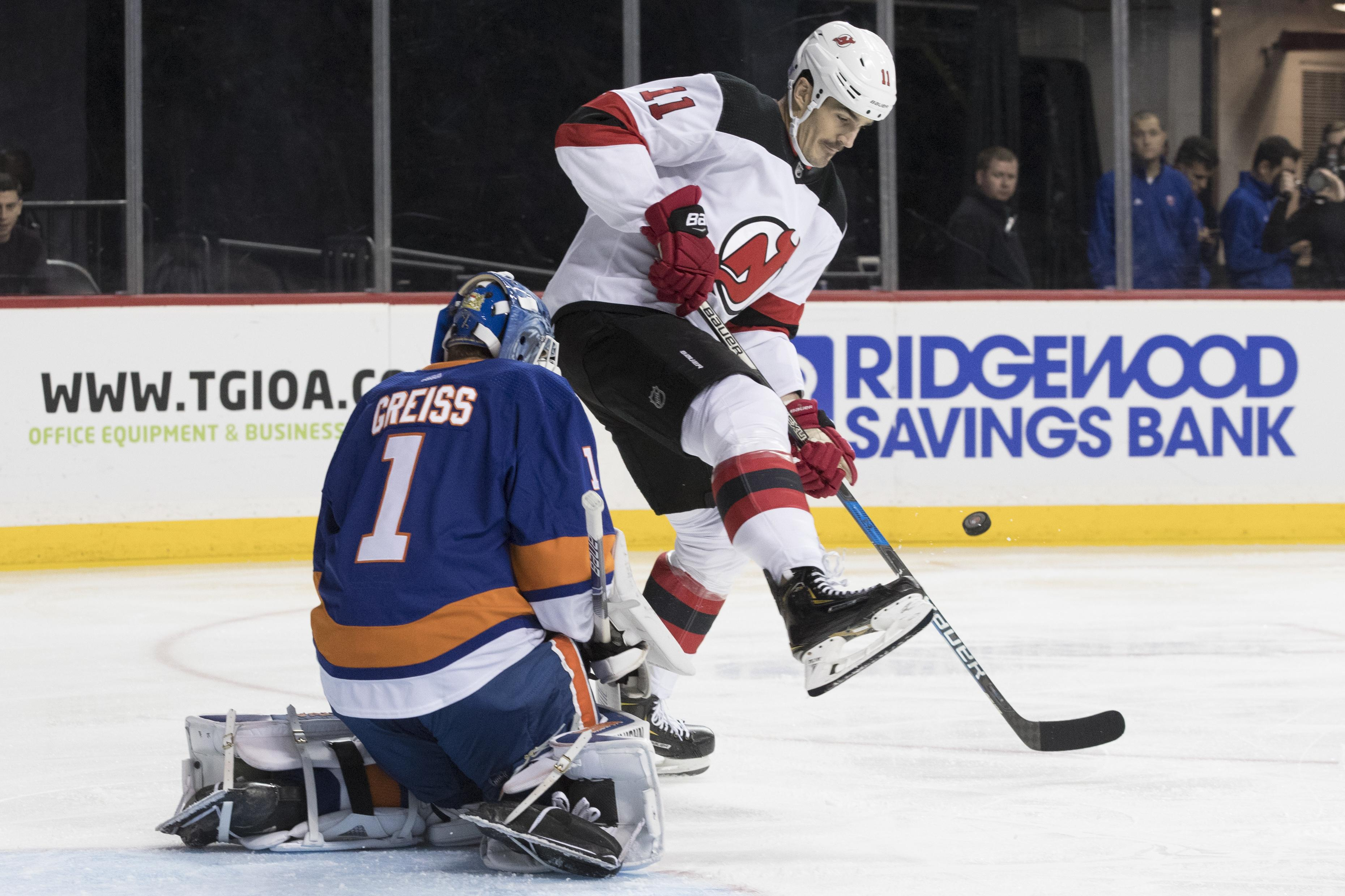 New York Islanders goaltender Thomas Greiss makes a save against New Jersey  Devils center Brian Boyle 98d904f17