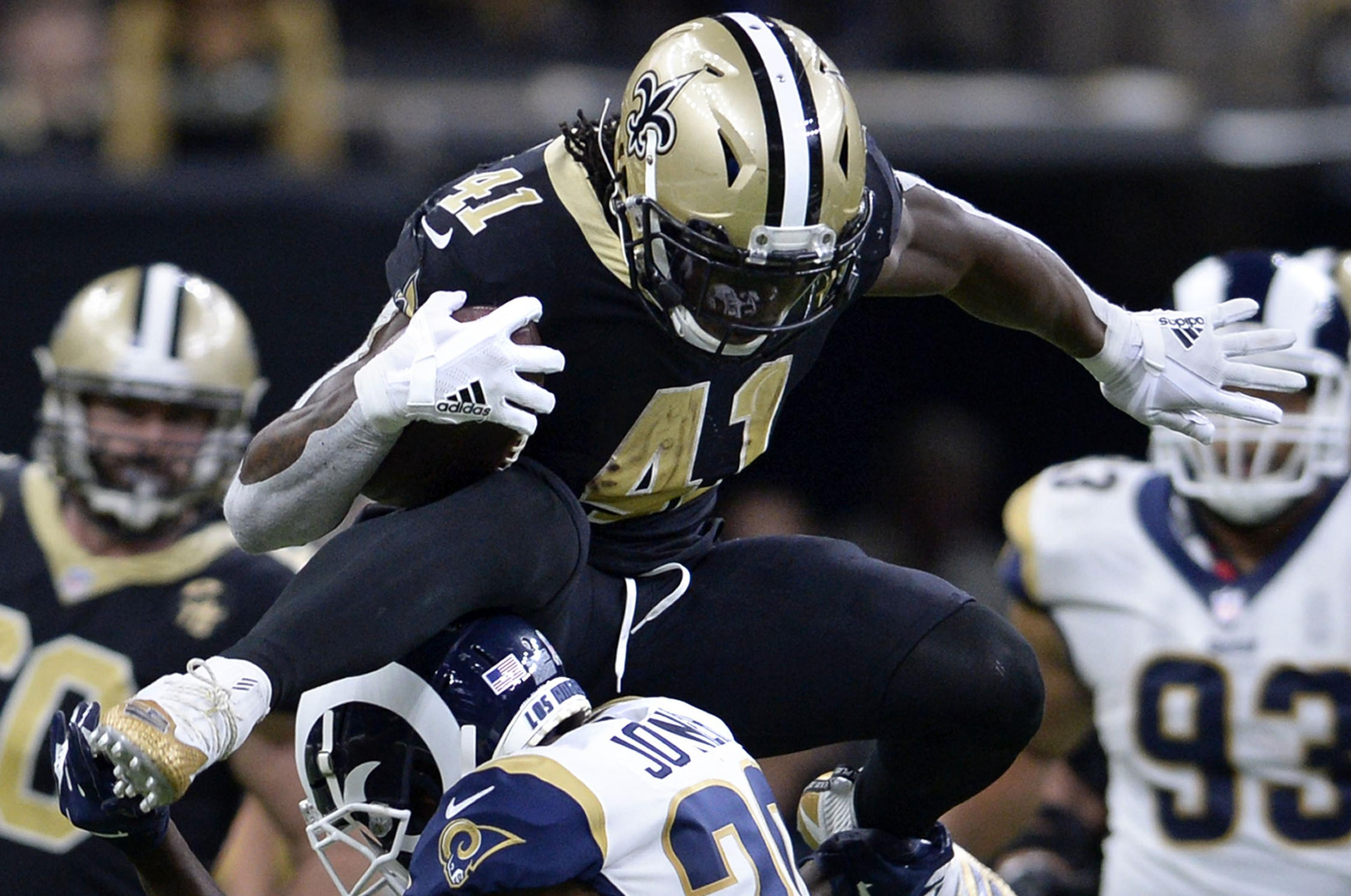 a5fbcc7a6 New Orleans Saints running back Alvin Kamara (41) leaps over Los Angeles  Rams free