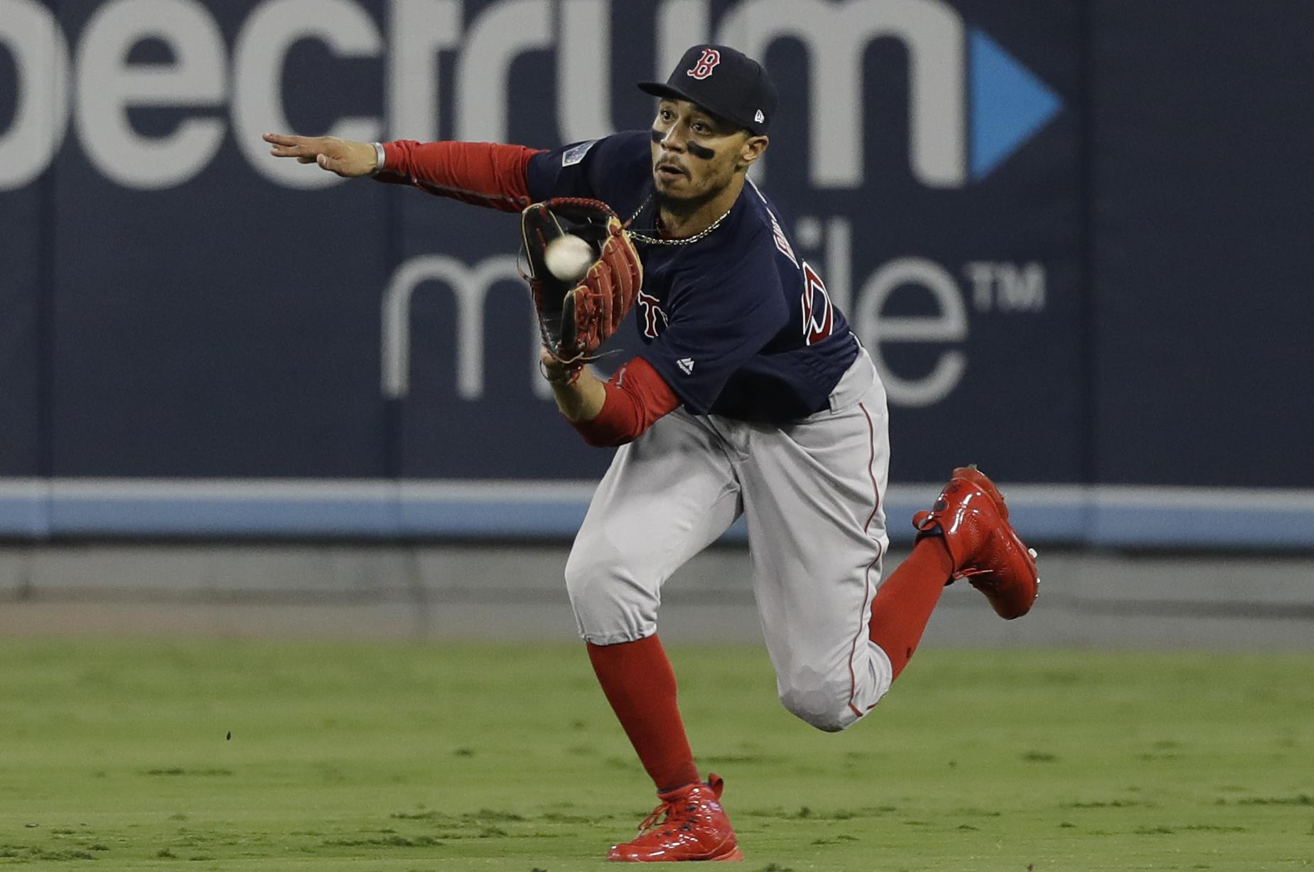 95e241ee6 Boston Red Sox center fielder Mookie Betts catches a fly ball by Los  Angeles Dodgers