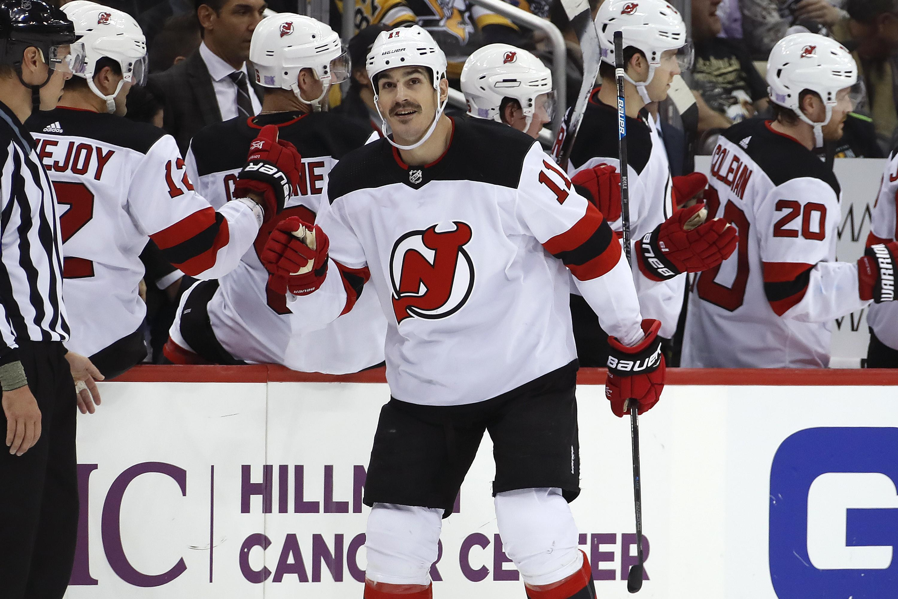 58a57b8794b The New Jersey bench congratulates Brian Boyle after his first career hat  trick in a 5