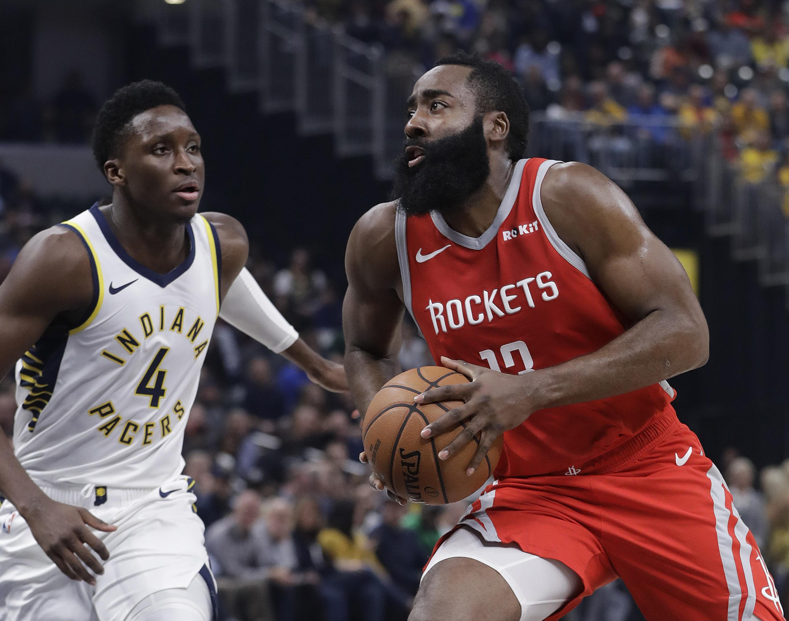 0f5d7c186ea5 Houston s James Harden drives to the basket against Indiana s Victor  Oladipo during first-half action