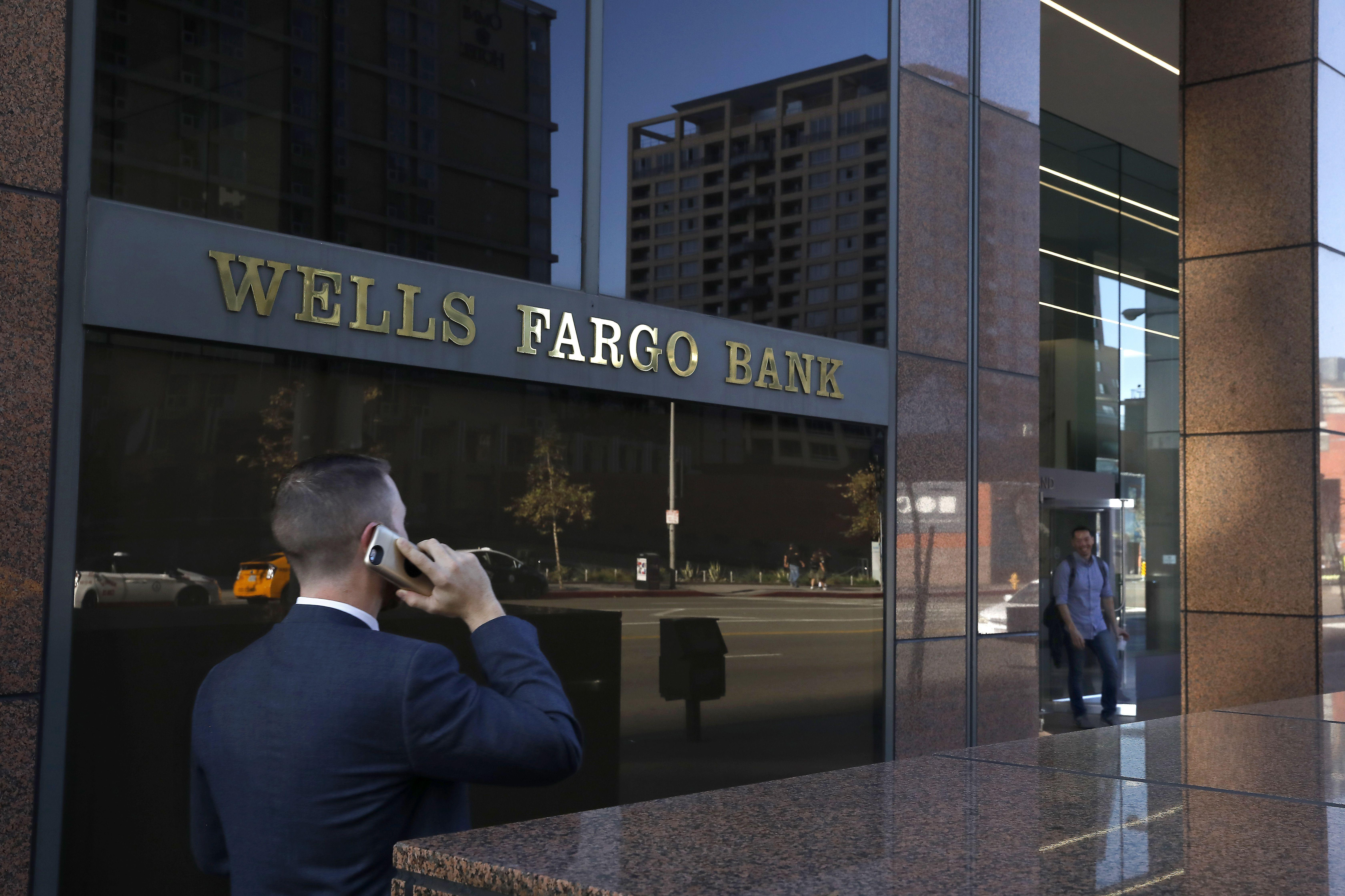 Wells Fargo says its error cost hundreds more people their