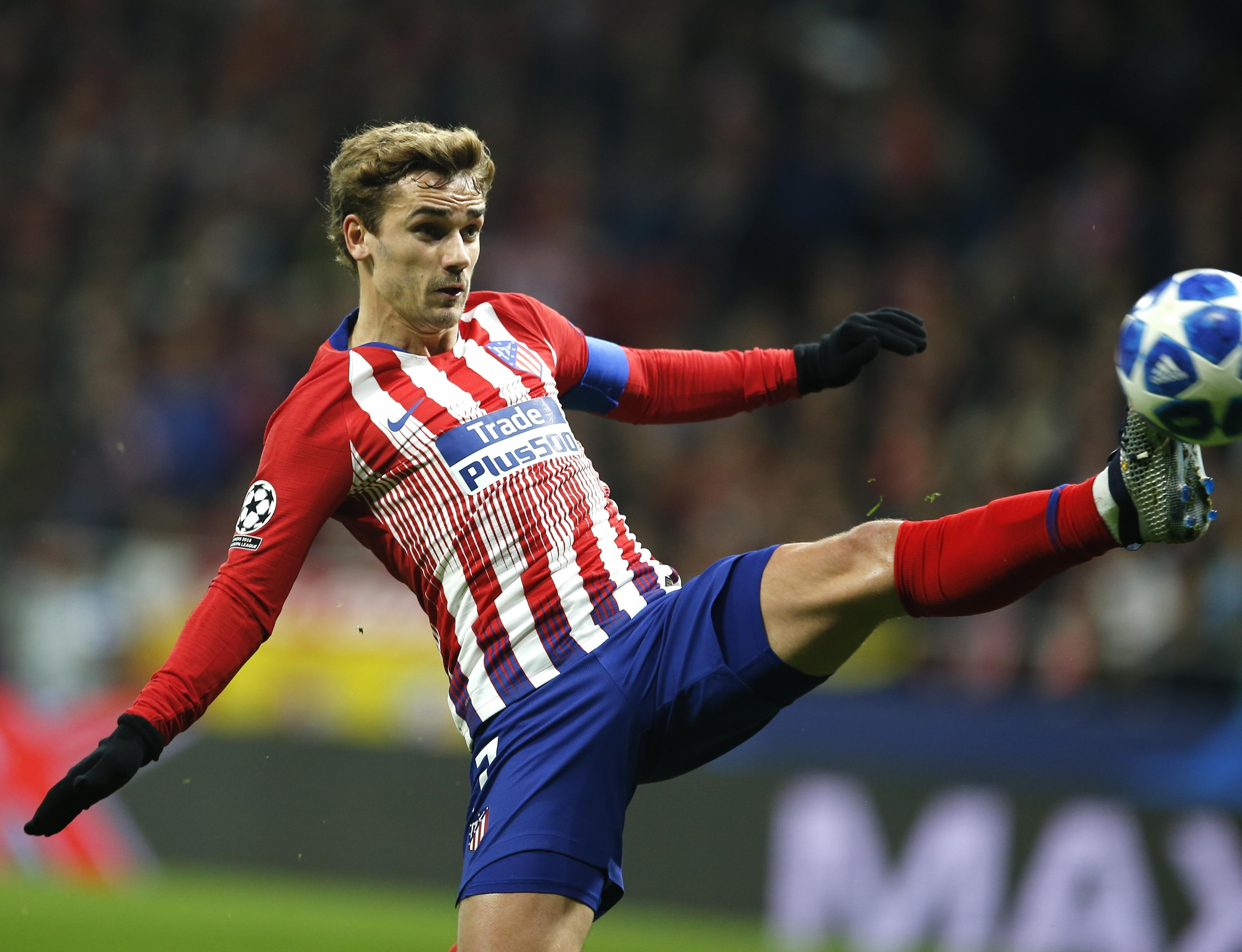 cd19f8a7ed0 Atletico Antoine Griezmann controls the ball during the Group A Champions  League soccer match between Atletico
