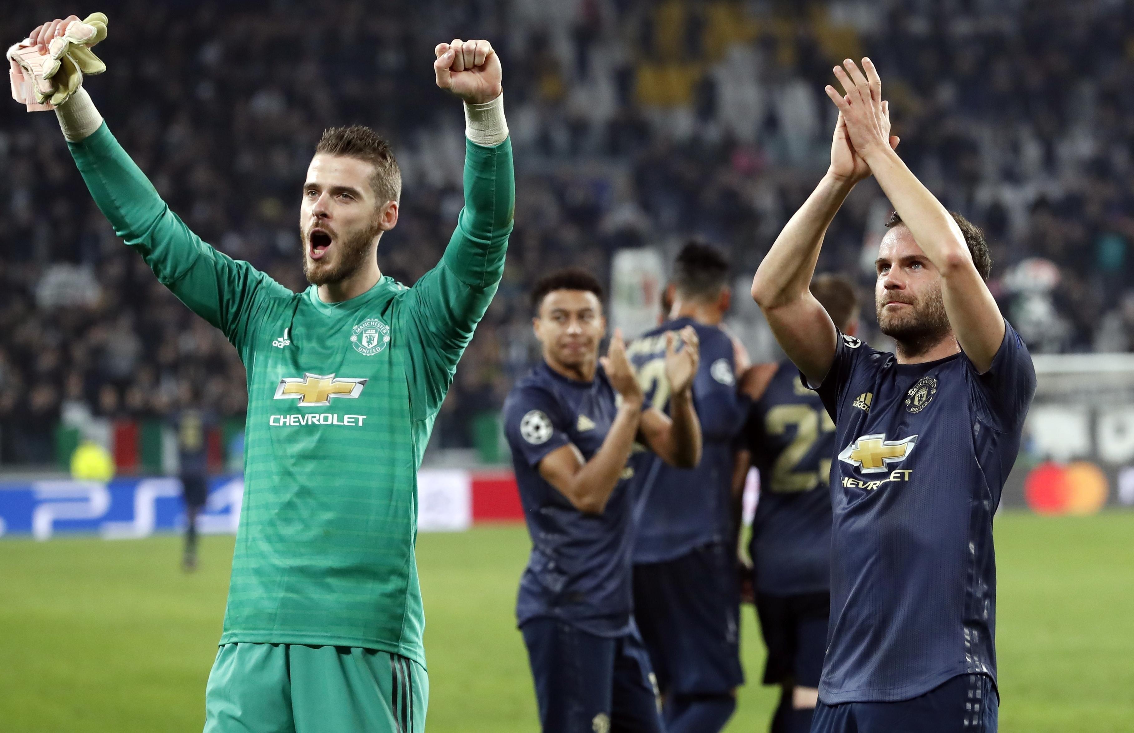 9691d5caa37 Manchester United goalkeeper David de Gea, left, and Juan Mata celebrate at  the end