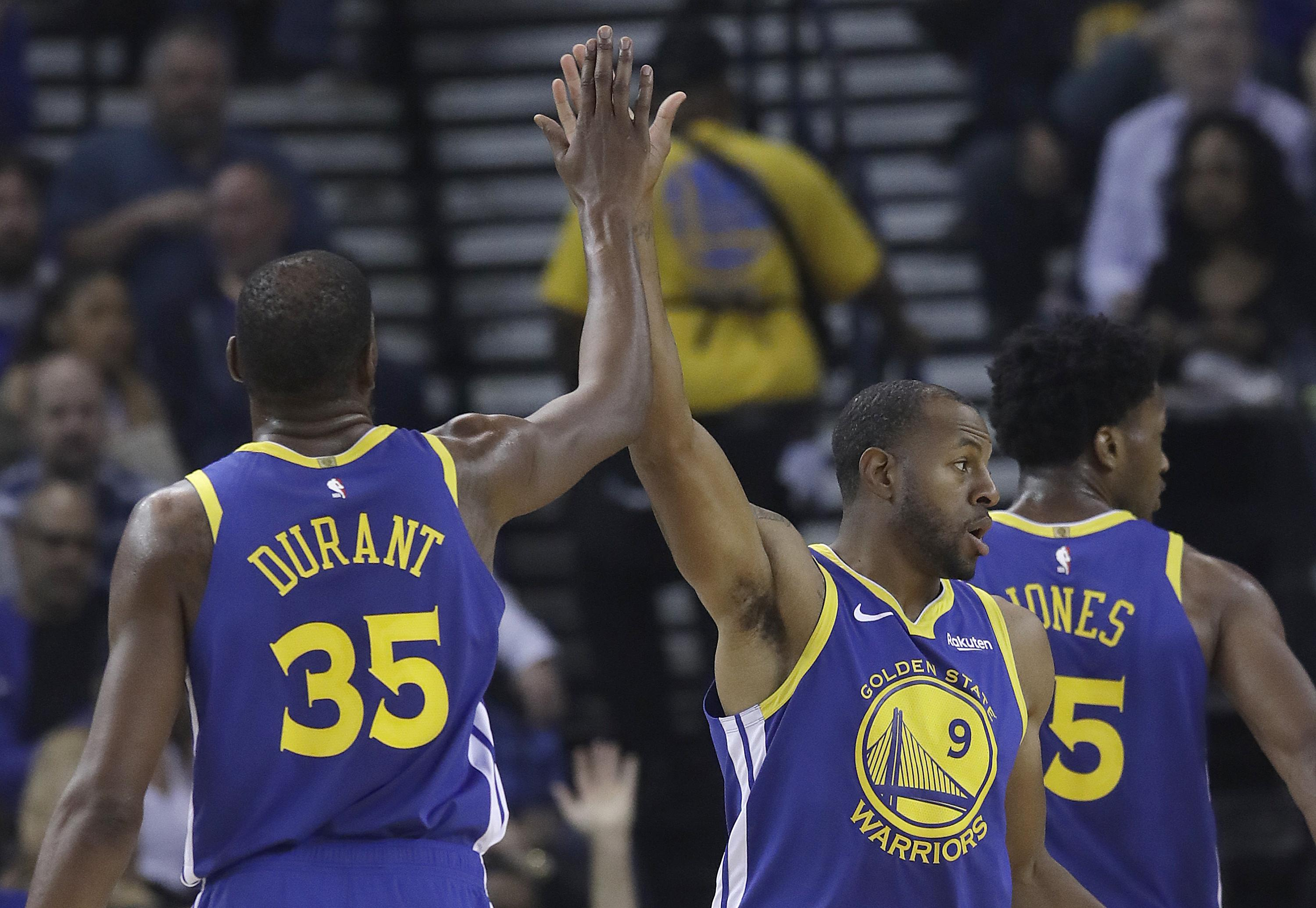 80db31e5e52a Golden State Warriors forward Kevin Durant (35) celebrates with forward  Andre Iguodala during the