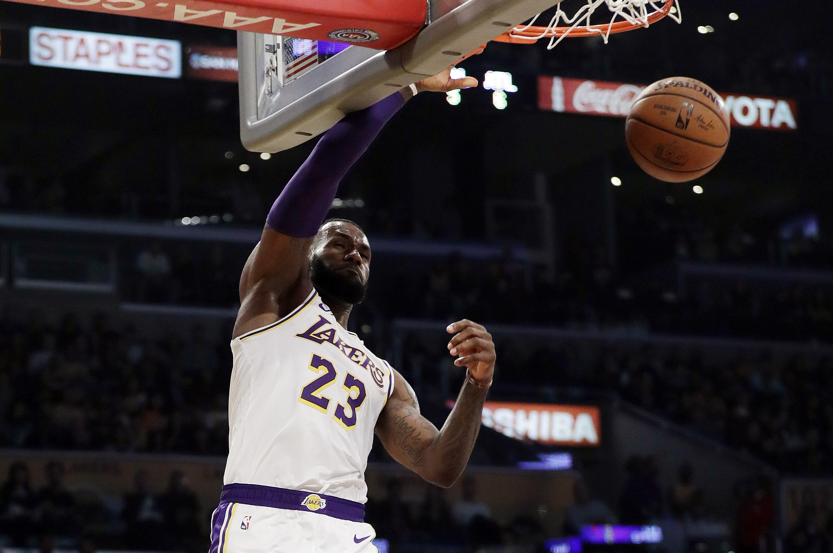 7eac2628cc8 Los Angeles Lakers  LeBron James (23) dunks against the Atlanta Hawks  during the