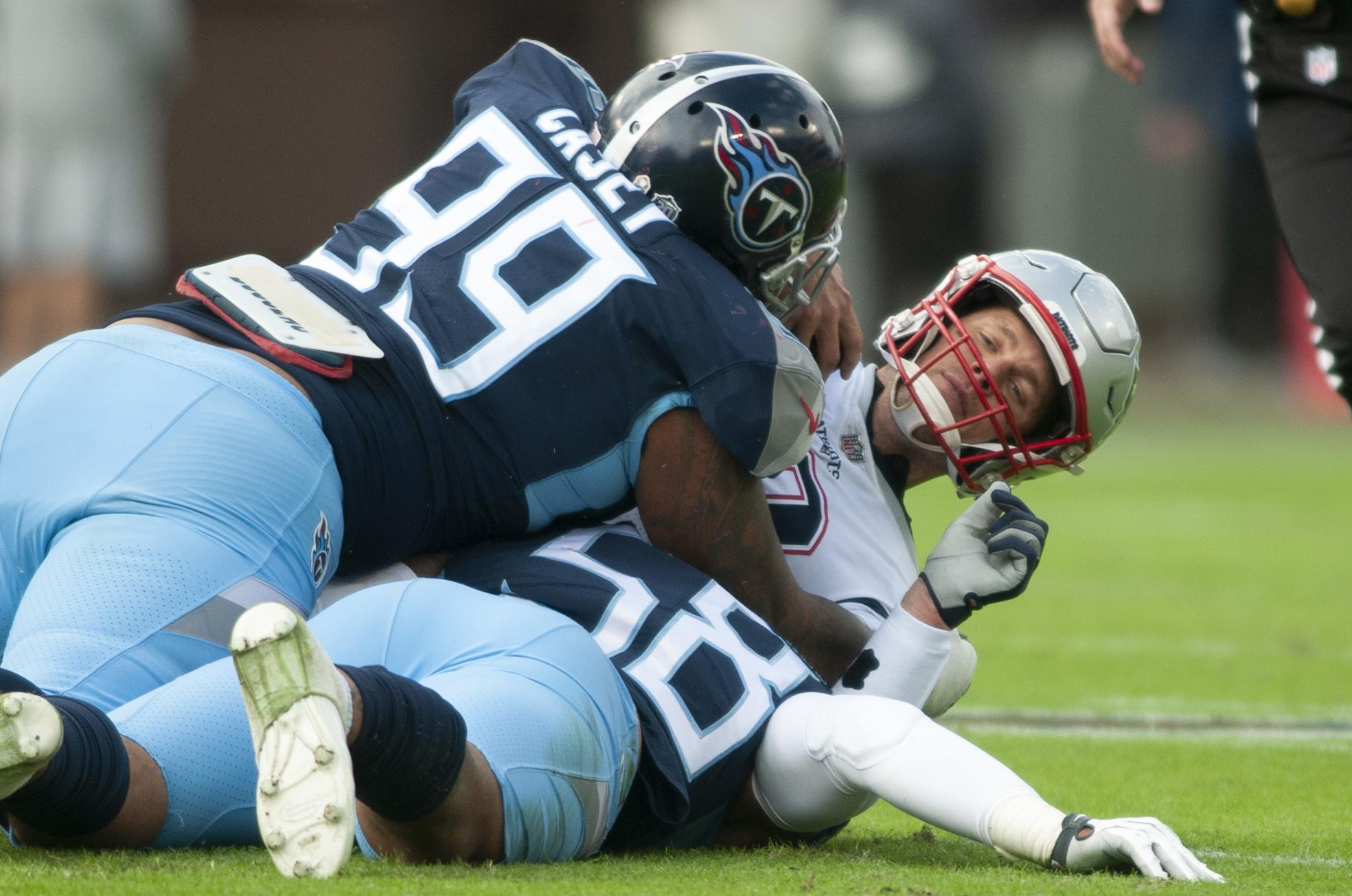 New England Patriots quarterback Tom Brady (12) is sacked by Tennessee  Titans defensive end a26099ac4