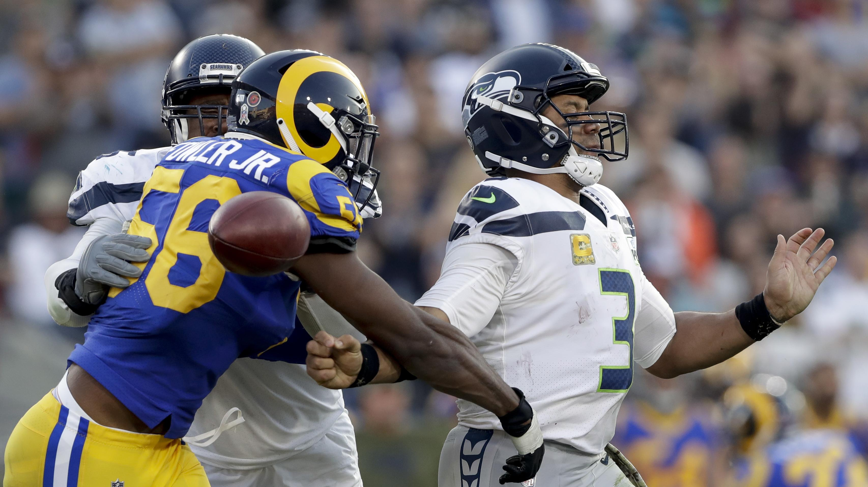 4c73e03b3d0 Los Angeles Rams defensive end Dante Fowler forces a fumble by Seattle  Seahawks quarterback Russell Wilson
