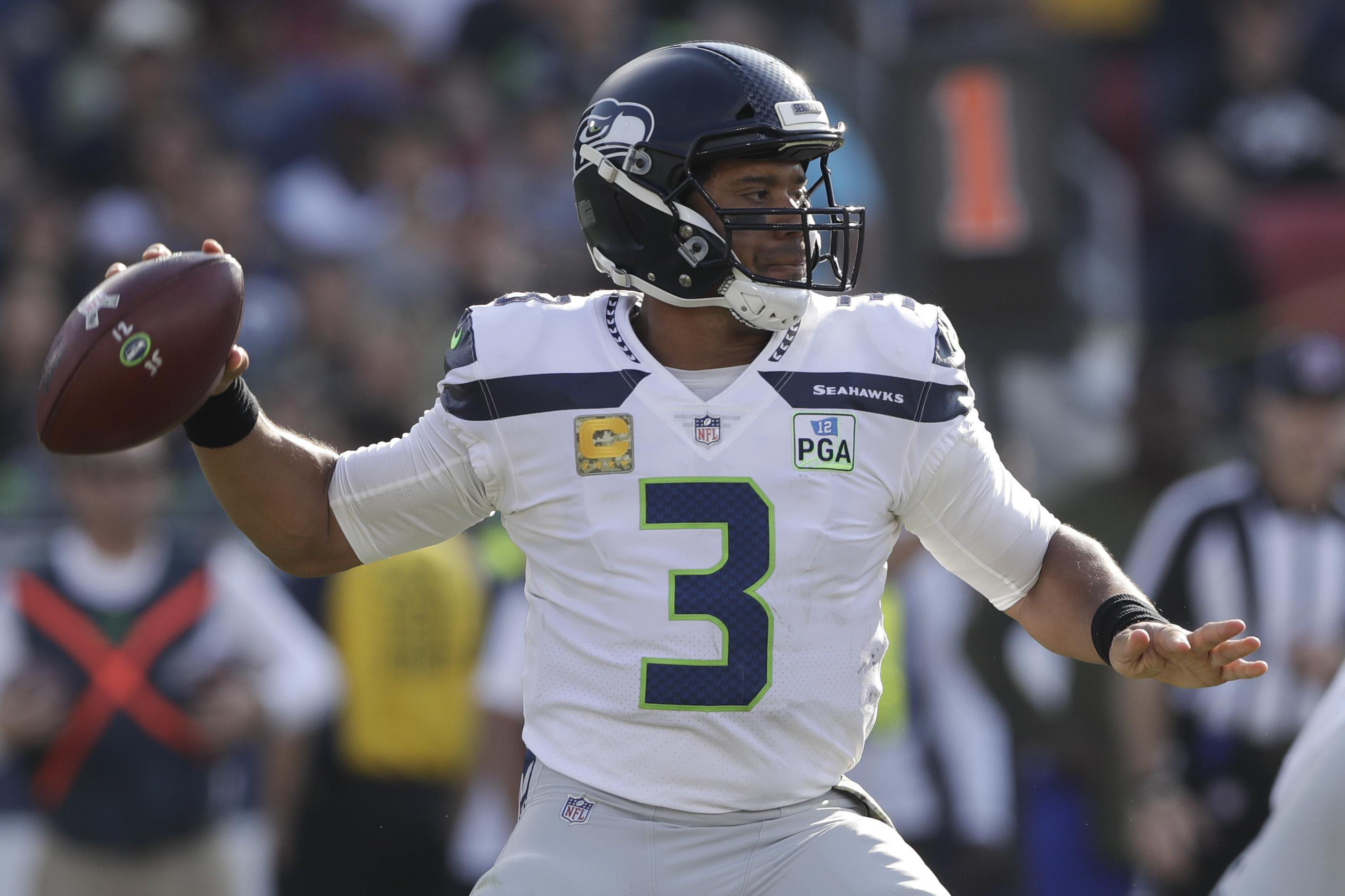 5700c031f Seattle Seahawks quarterback Russell Wilson passes against the Los Angeles  Rams during the first half Sunday