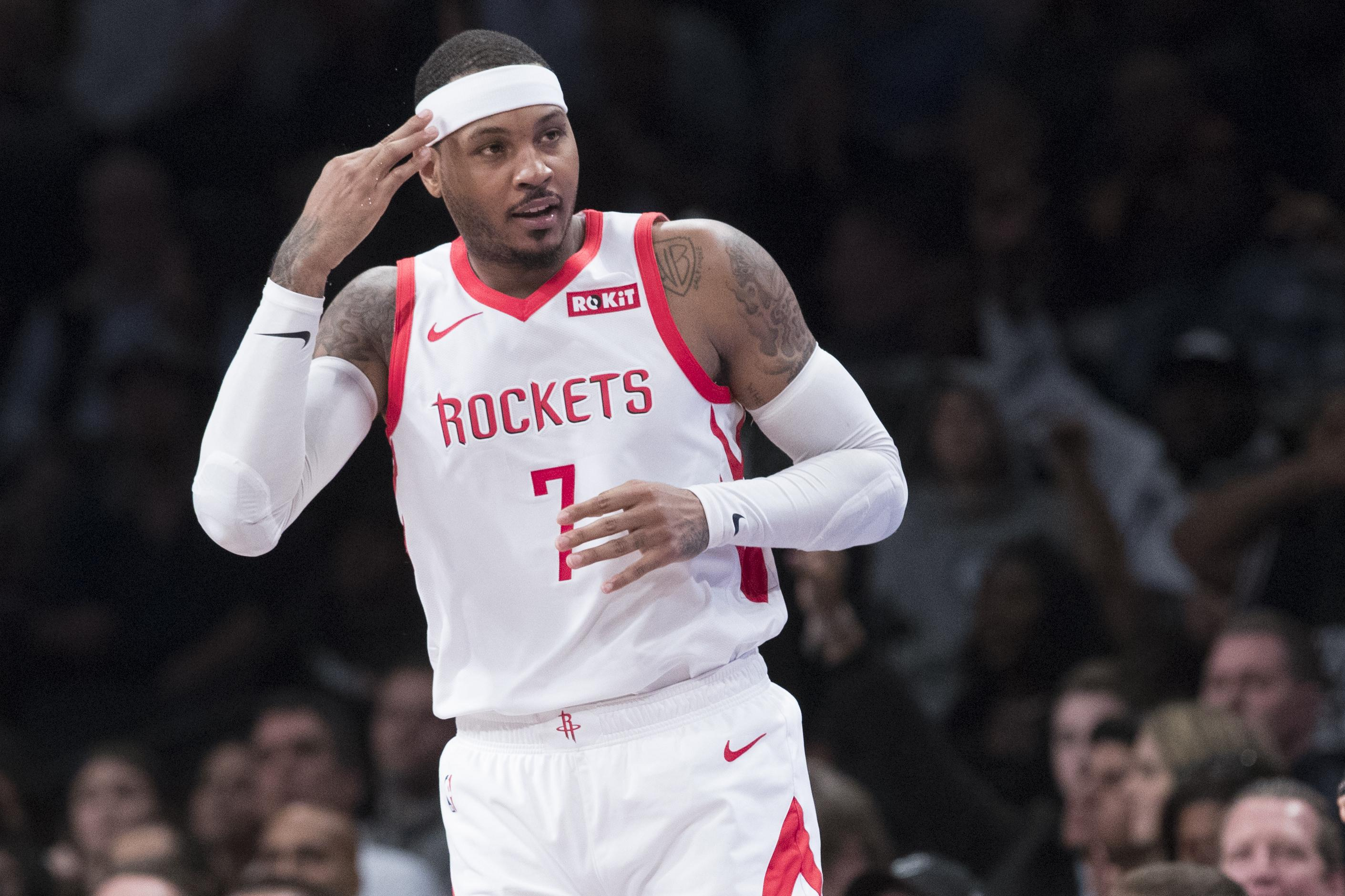 Houston Rockets forward Carmelo Anthony (7) reacts after making a  three-pointer. 260dbf0a1