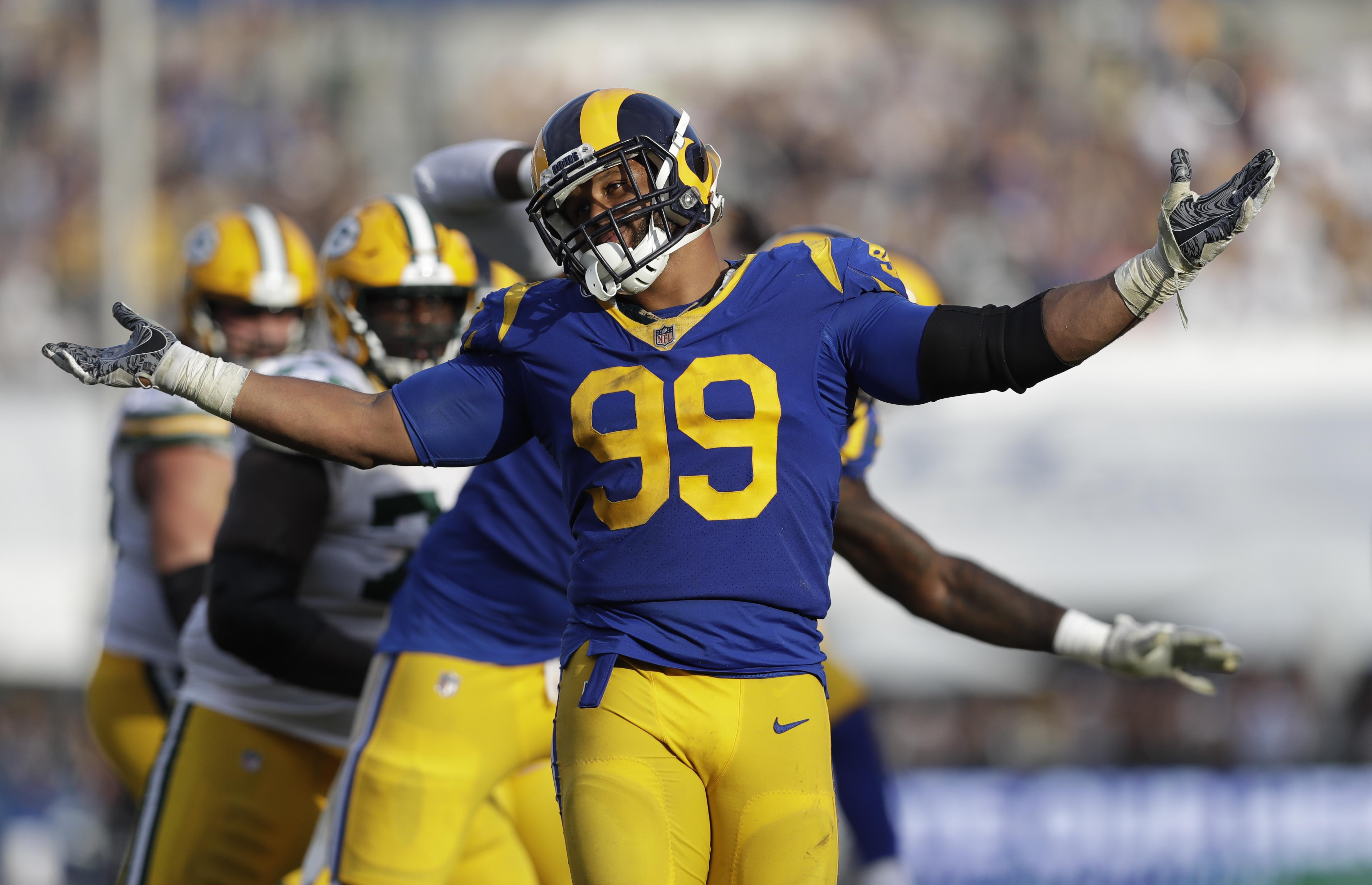 fd2045ff3 Los Angeles Rams defensive tackle Aaron Donald reacts after sacking Green  Bay Packers quarterback Aaron Rodgers