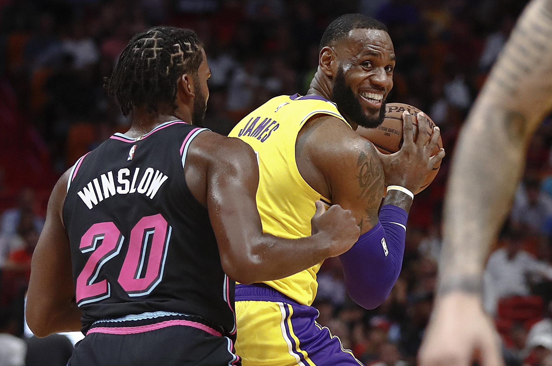 b91cd7d8d20 Los Angeles Lakers forward LeBron James keeps the ball from Miami Heat  forward Justise Winslow during