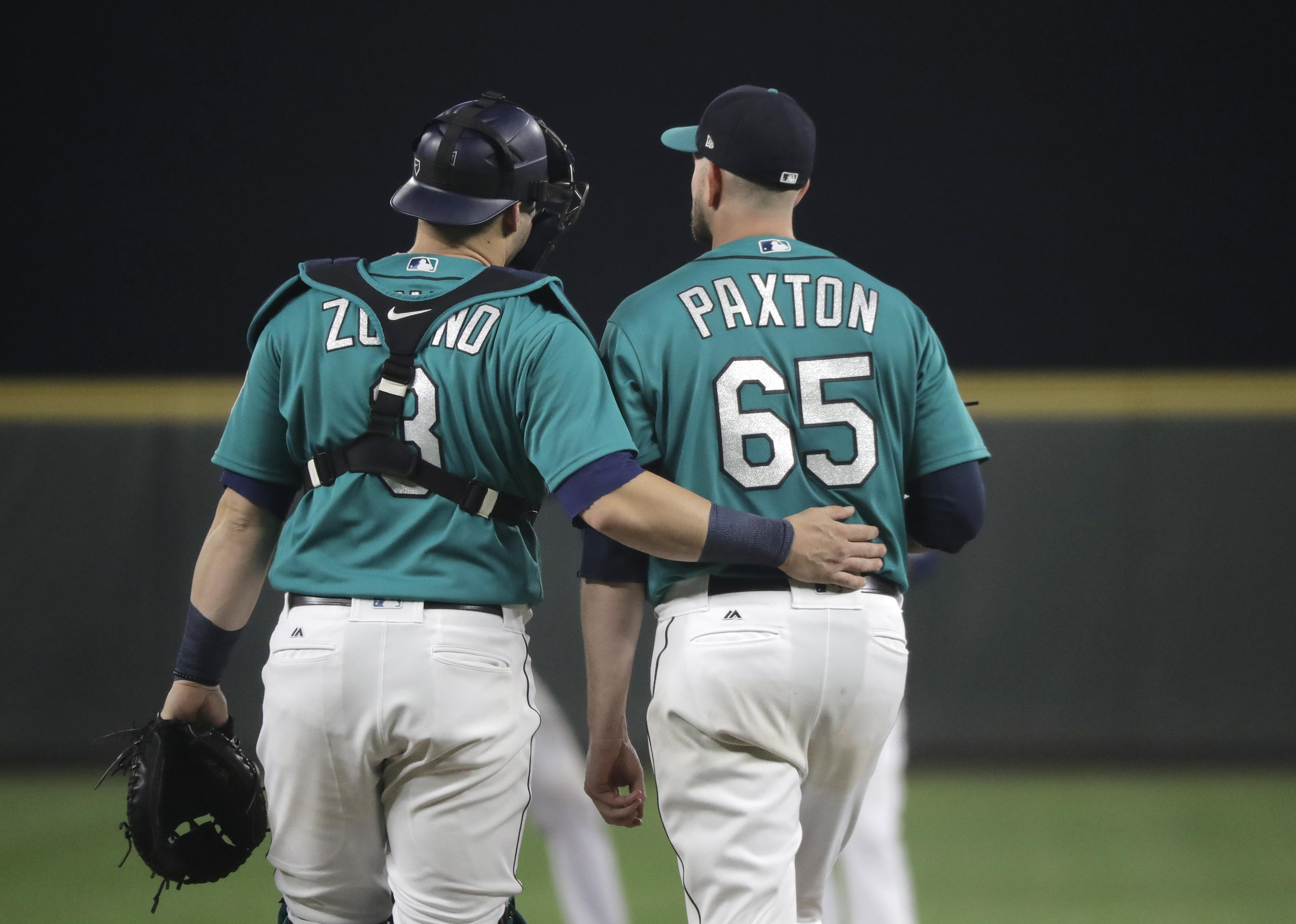 ba1fd9090 Seattle Mariners starting pitcher James Paxton walks with catcher Mike  Zunino at the start of the