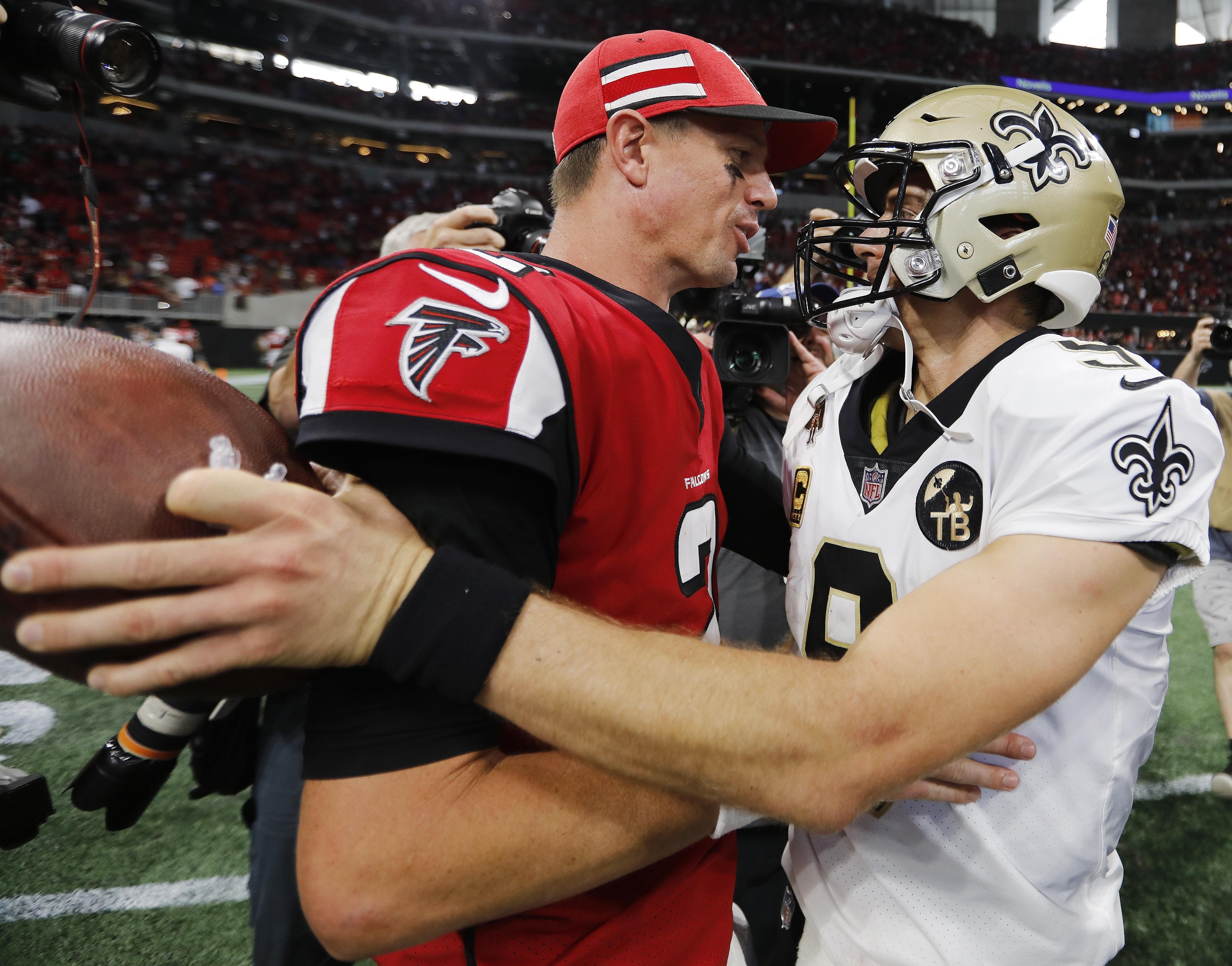 Atlanta Falcons quarterback Matt Ryan (2) speaks with New Orleans Saints quarterback  Drew Brees e6fe85f95