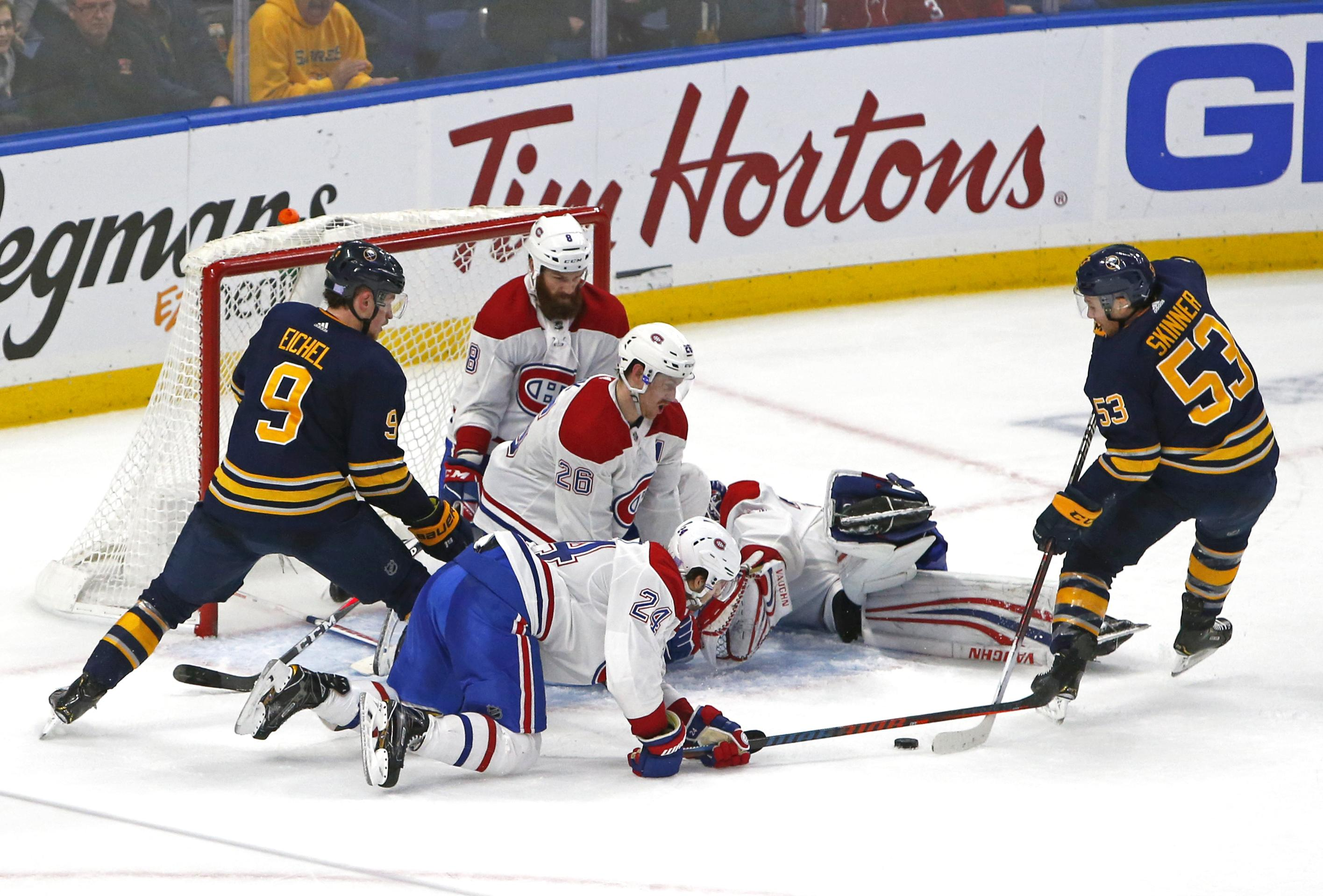 76c3c11ea Buffalo Sabres forward Jeff Skinner, right, scores the game-winning goal in  overtime