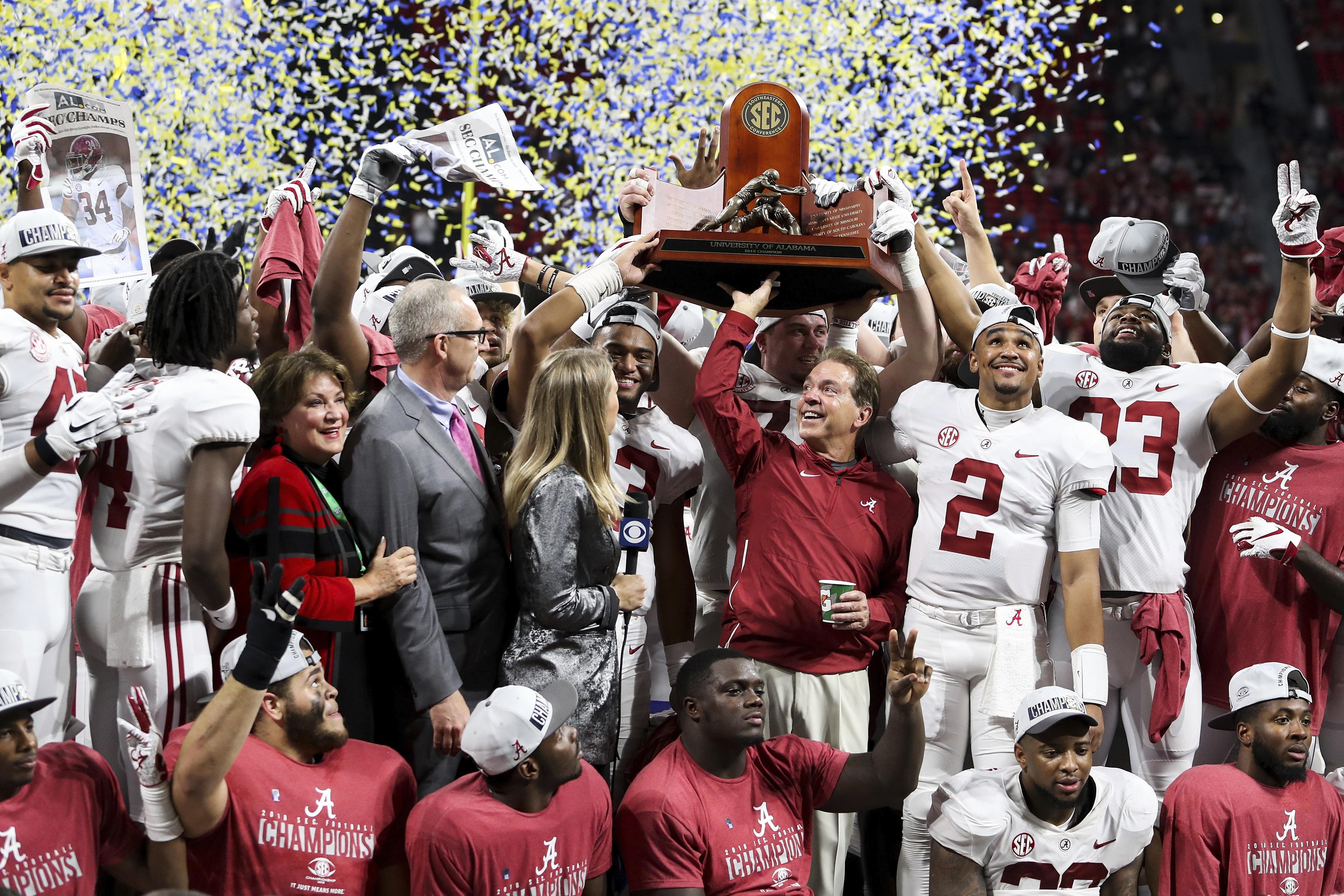 78613d47d2a Alabama raises the trophy after defeating Georgia in the Southeastern  Conference championship Saturday in Atlanta.