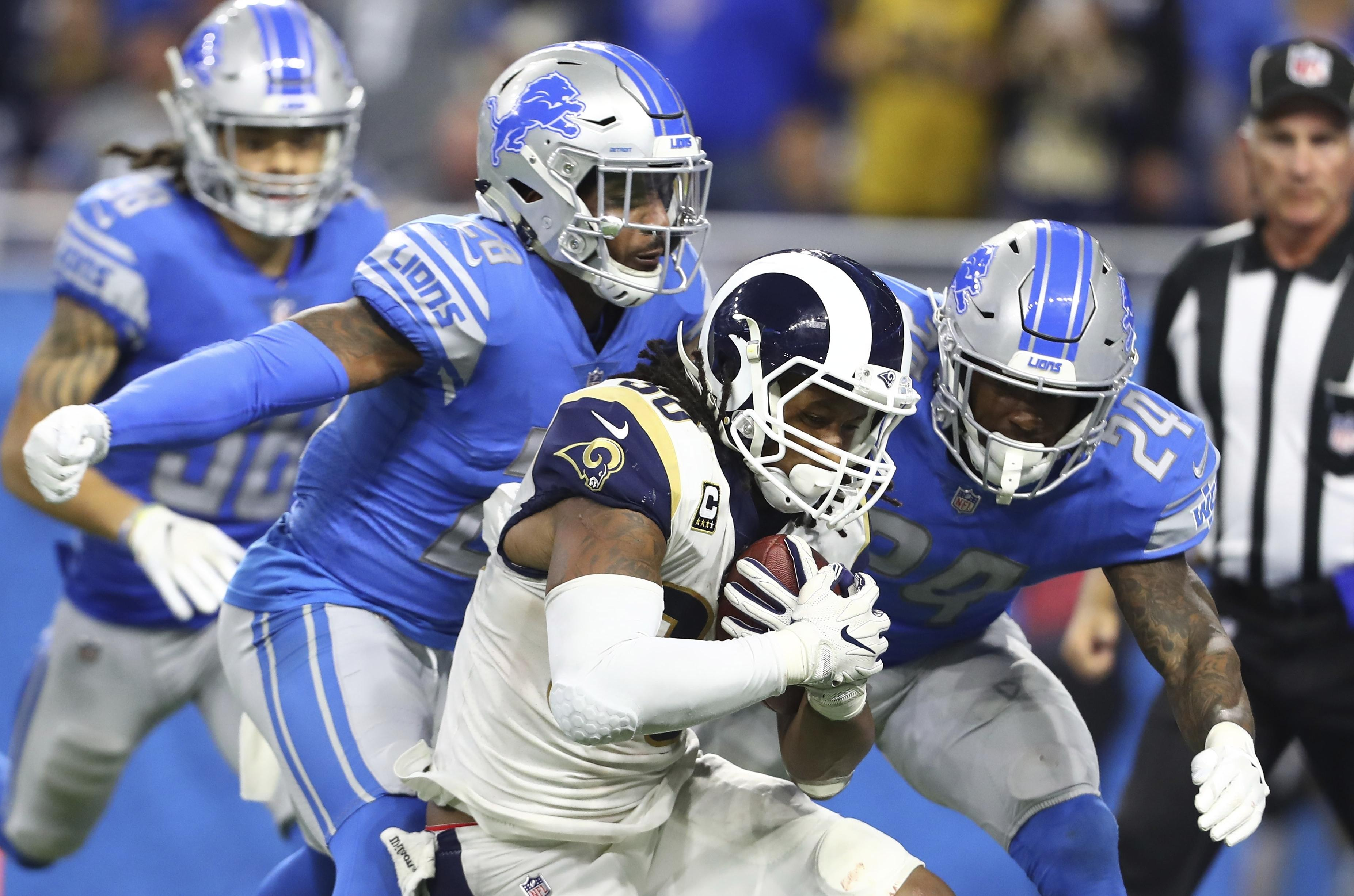 5a7bc133d7f Los Angeles Rams running back Todd Gurley is tackled by Detroit Lions  cornerback Nevin Lawson (