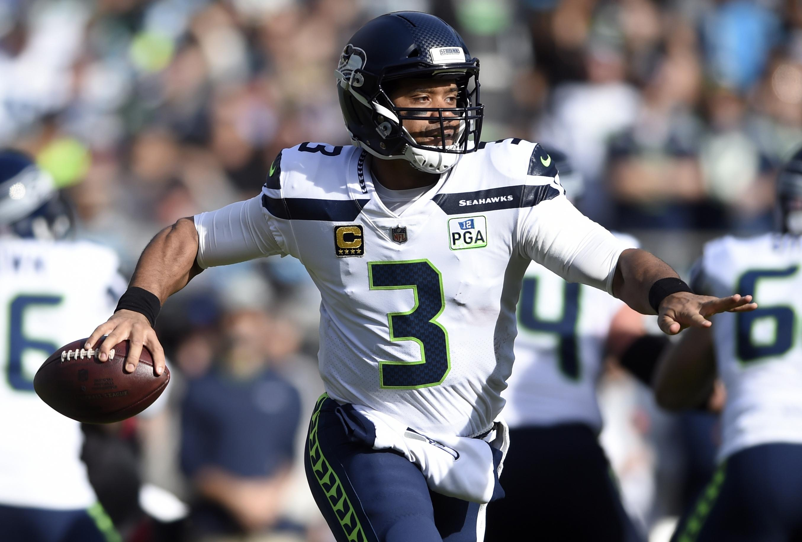 Seattle Seahawks  Russell Wilson (3) looks to pass against the Carolina  Panthers during 6e74c4806