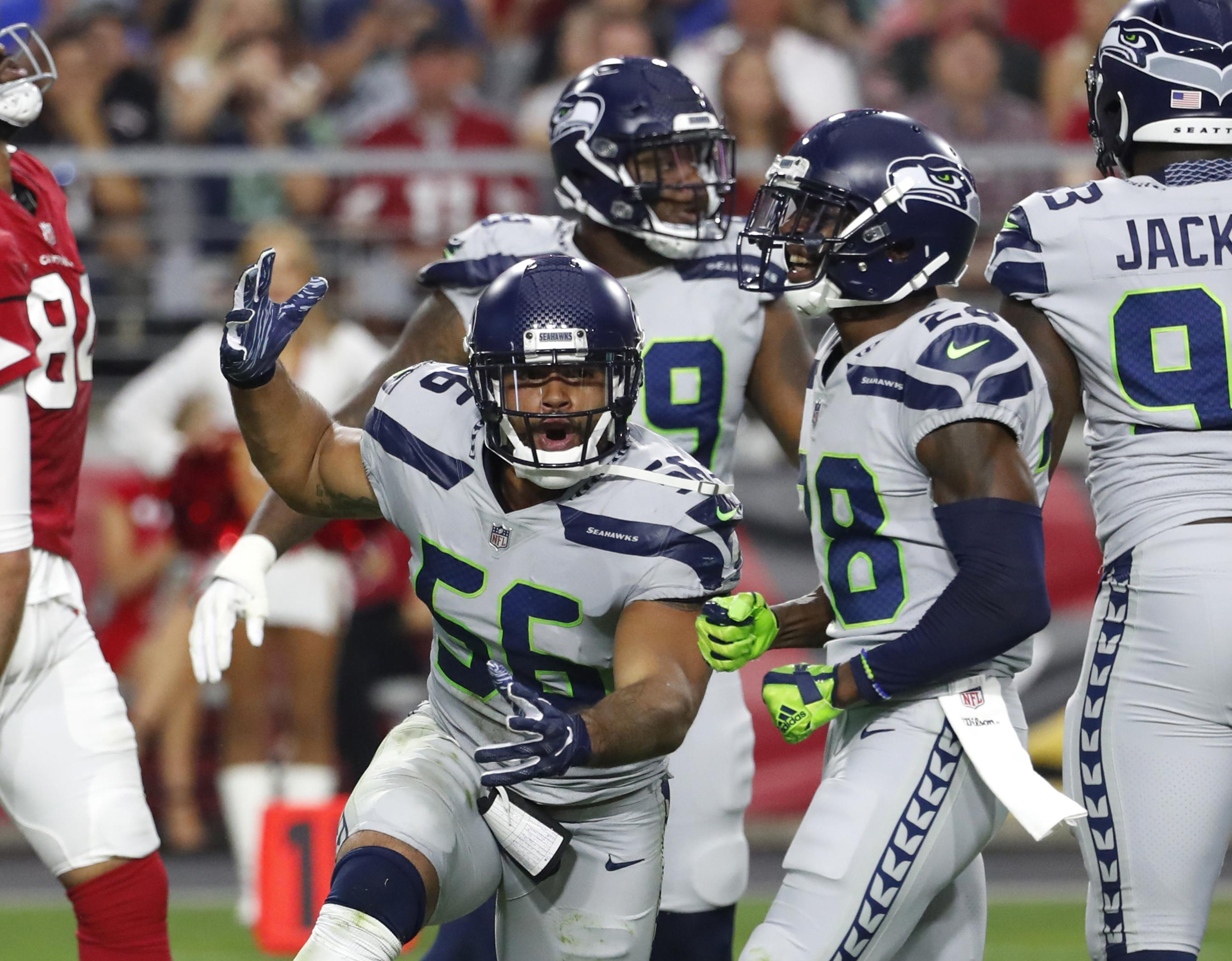 dcc133830 Seattle Seahawks linebacker Mychal Kendricks gestures during the team s NFL  football game against the Arizona Cardinals