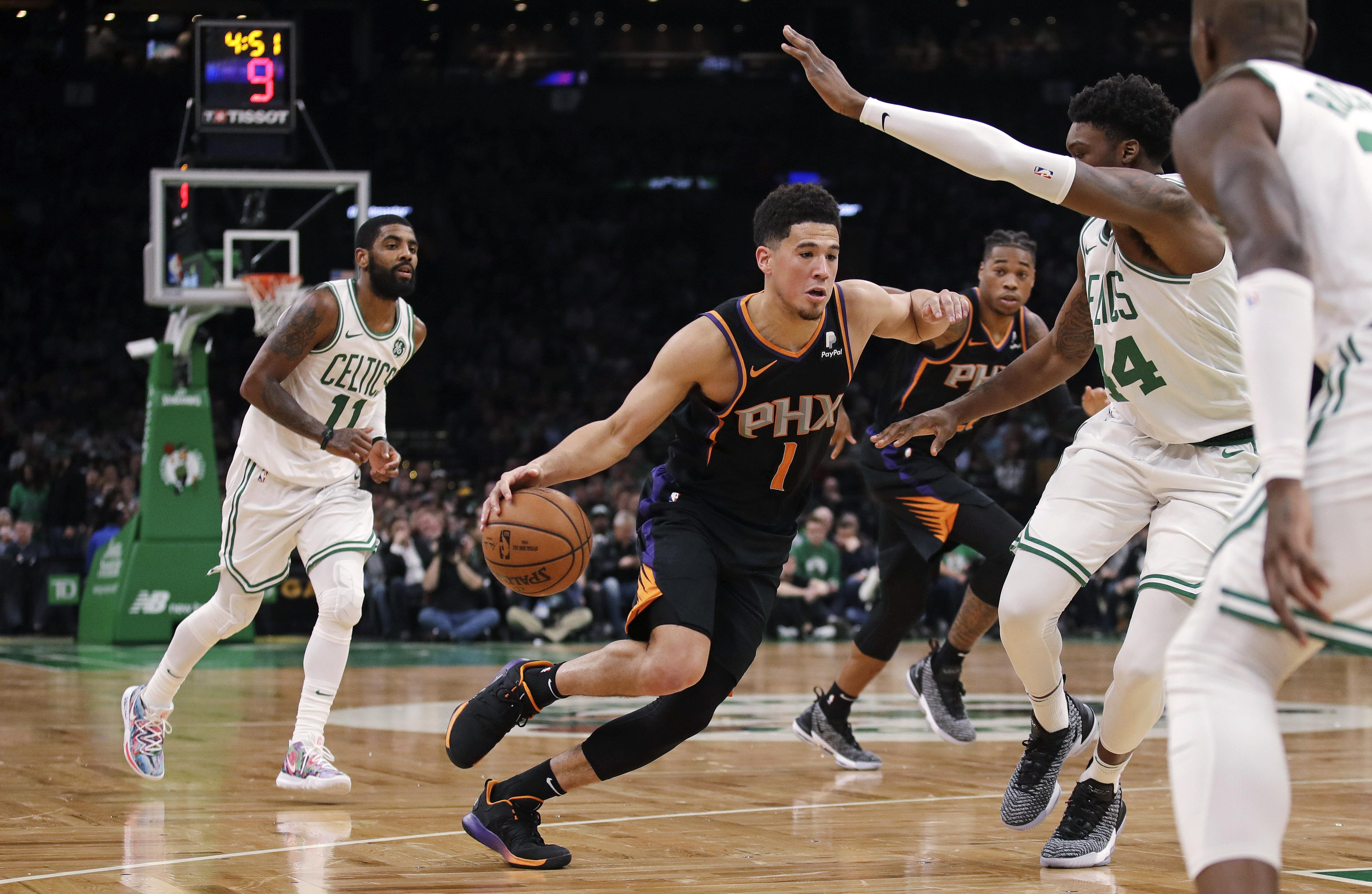 1bcee58be7c0 Phoenix Suns guard Devin Booker scored 25 points and handed out eight  assists in a 111
