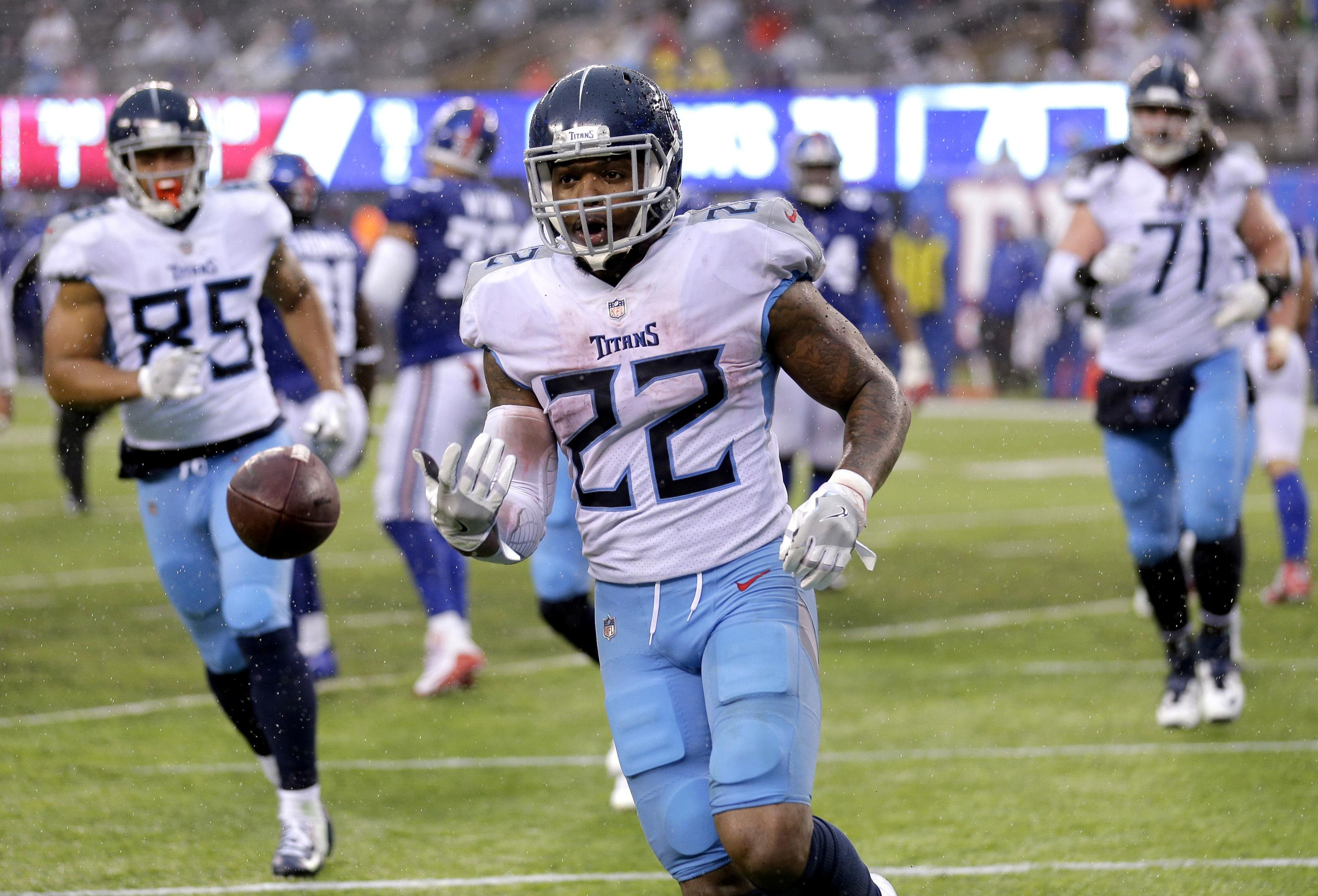 3a512d190ac Tennessee Titans running back Derrick Henry (22) tosses the ball to an  official after
