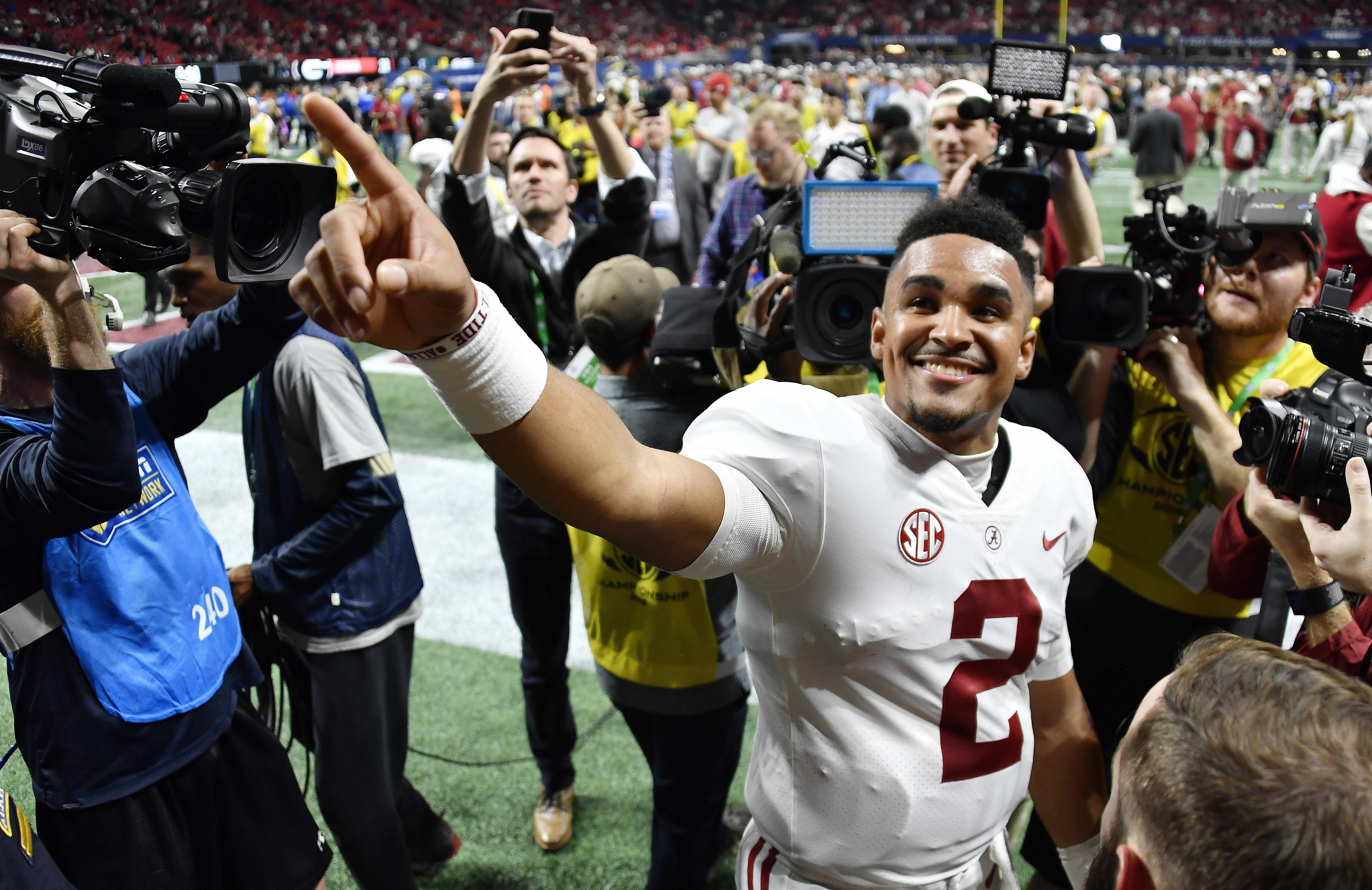 eca3e234315 Alabama quarterback Jalen Hurts speaks to fans after the Southeastern  Conference championship game against Georgia on