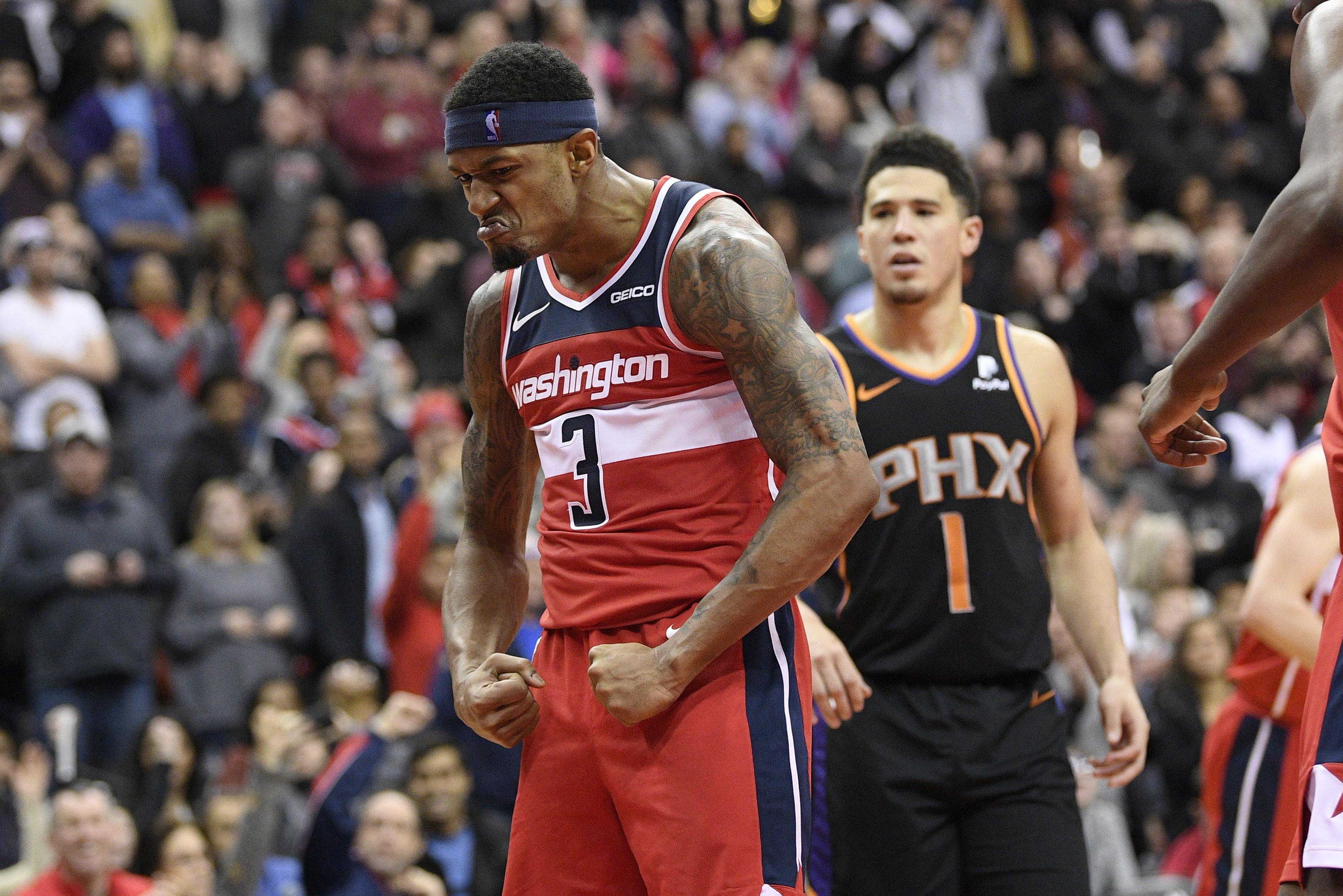 6f0bc8045 Washington Wizards guard Bradley Beal (3) reacts after he made a basket  during triple