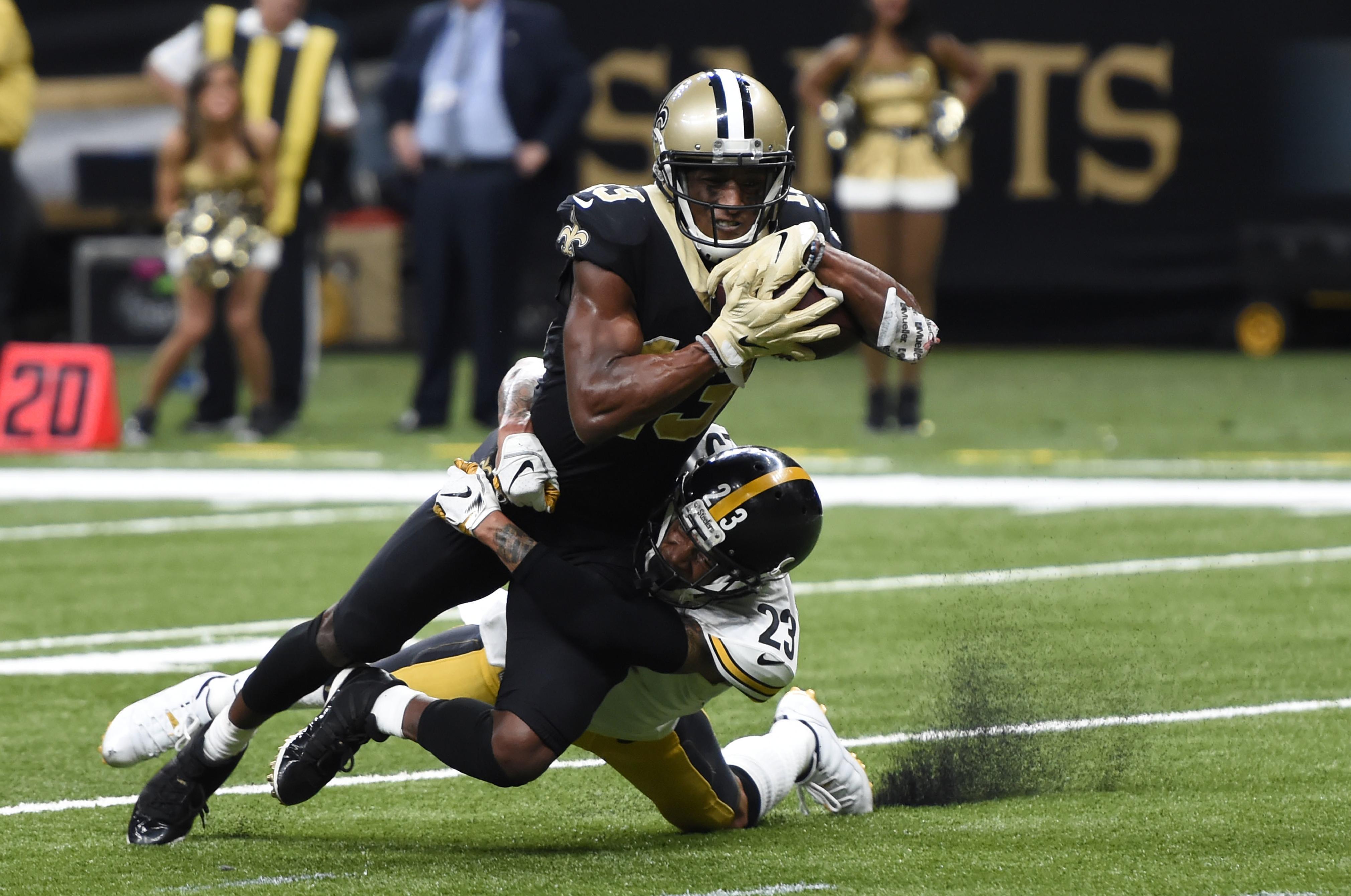 c5d5e7ed683c60 Pittsburgh Steelers cornerback Joe Haden (23) tackles New Orleans Saints  wide receiver Michael Thomas